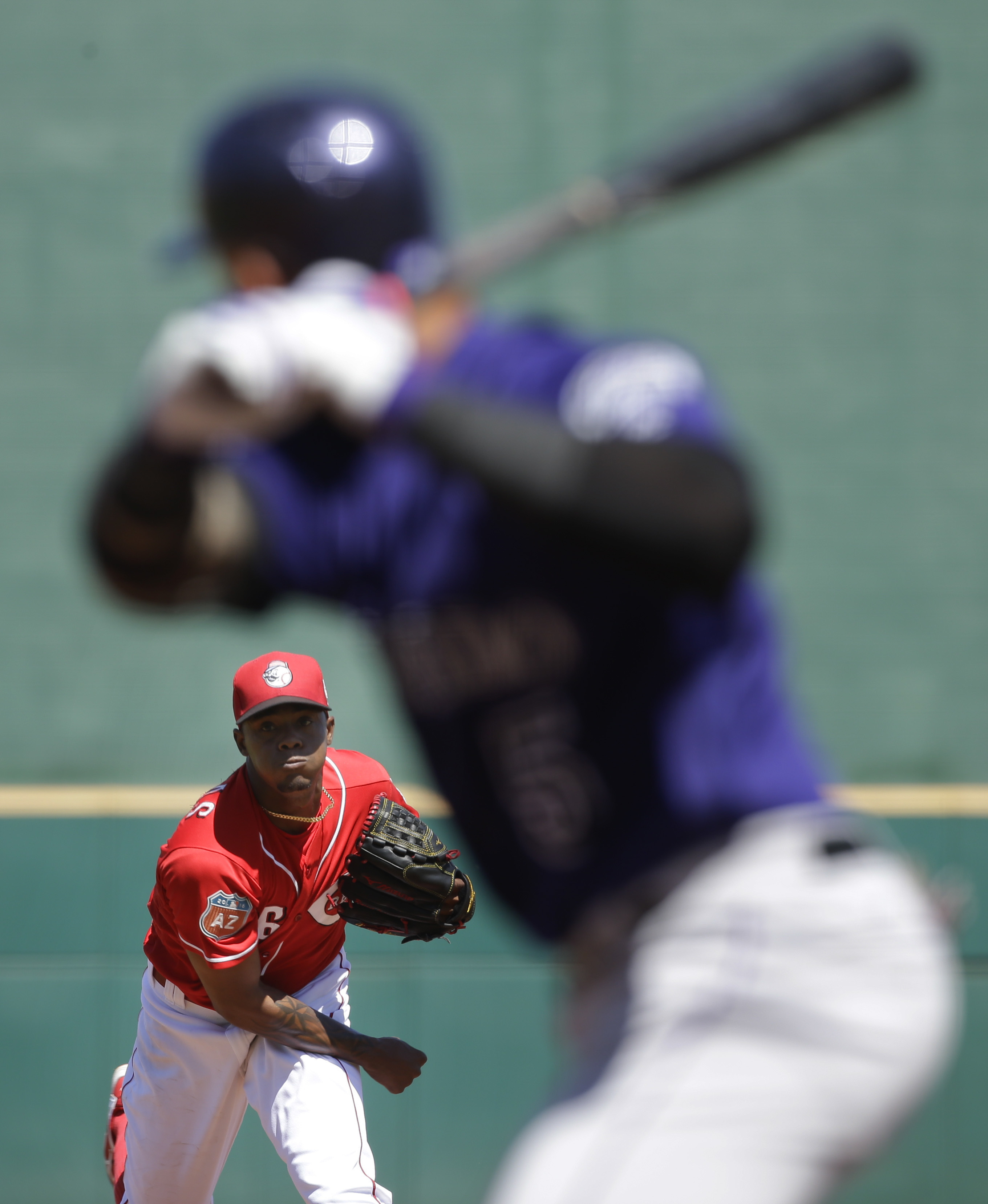 Cincinnati Reds starting pitcher Raisel Iglesias throws to Colorado Rockies' Carlos Gonzalez during the first inning of a spring training baseball game Friday, March 25, 2016, in Goodyear, Ariz. (AP Photo/Jae C. Hong)