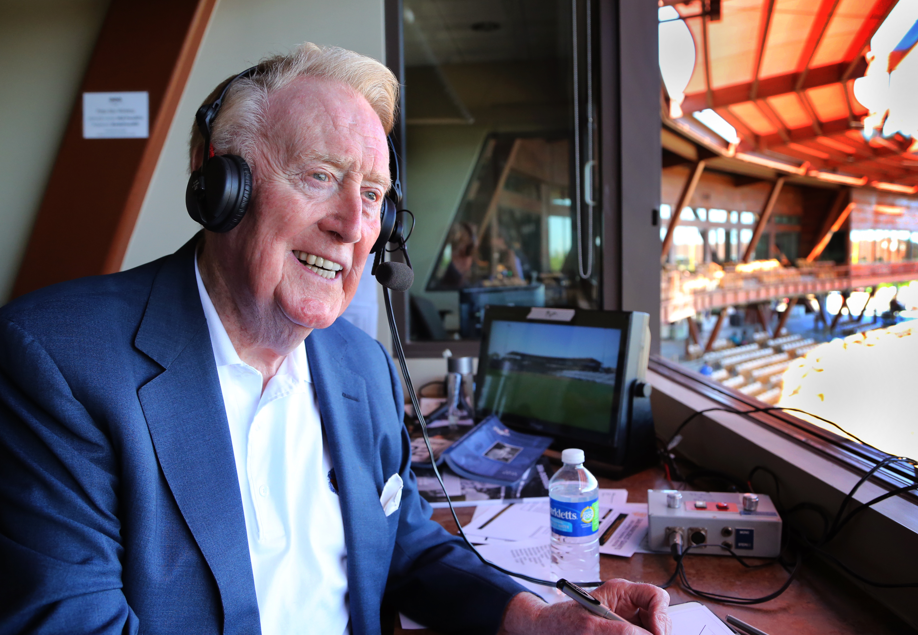 Legendary Los Angeles Dodgers broadcaster Vin Scully sits in the booth at Camelback Ranch Glendale, Ariz., ballpark Friday, March 25, 2016, the day of the last broadcast he will do from the park. (Tom Tingle/The Arizona Republic via AP)