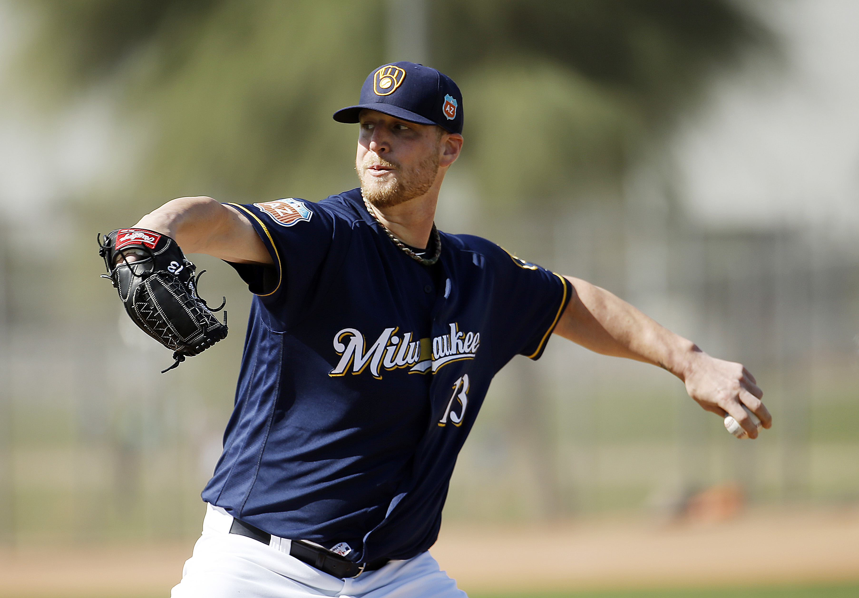 Milwaukee Brewers' Will Smith throws during a spring training baseball workout Tuesday, March 1, 2016, in Phoenix. (AP Photo/Morry Gash)