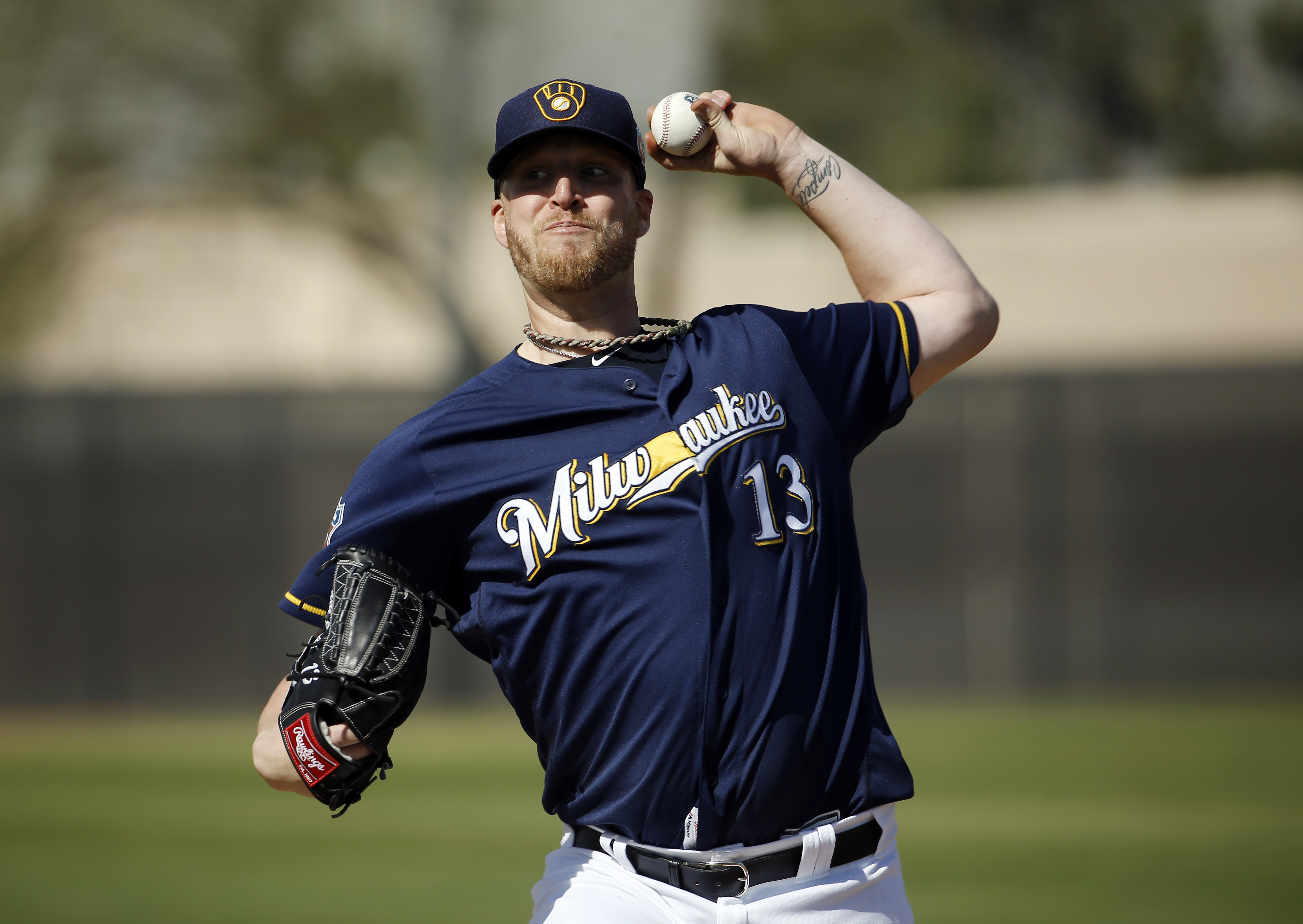 FILE - In this Tuesday, March 1, 2016 file photo, Milwaukee Brewers' Will Smith throws during a spring training baseball workout in Phoenix. The Milwaukee Brewers will start the season without reliever Will Smith, who tore a ligament in his right knee whi