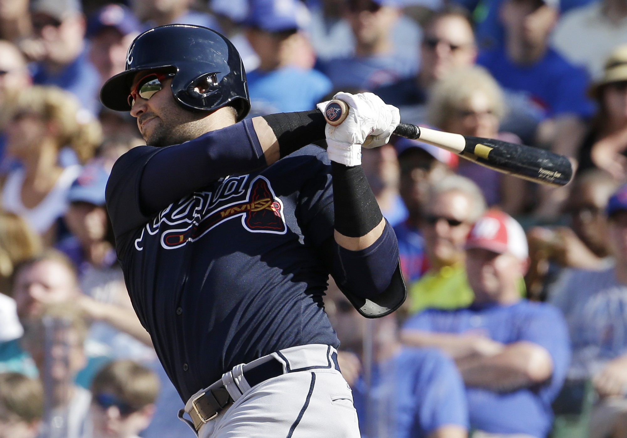 FILE - In this Aug. 22, 2015, file photo, Atlanta Braves' Nick Swisher hits a two-run home run against the Chicago Cubs during the fifth inning of a baseball game in Chicago. The Braves have released Swisher. (AP Photo/Nam Y. Huh, File)