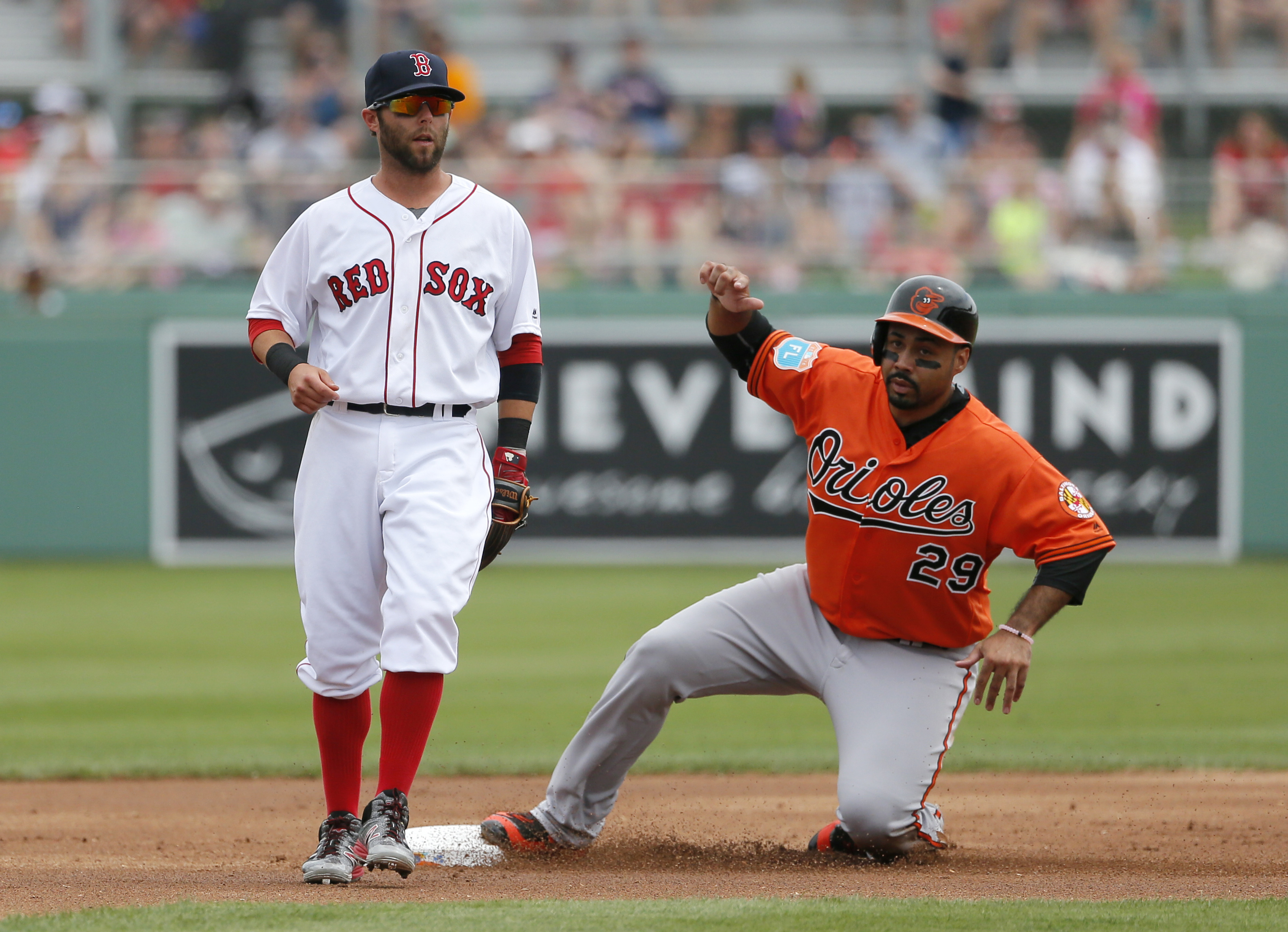 Boston Red Sox's Dustin Pedroia, left, stands by as Baltimore Orioles' Pedro Alvarez steals second while Nolan Reimold was at-bat in the first inning of a spring training baseball game, Monday, March 28, 2016, in Fort Myers, Fla. (AP Photo/Tony Gutierrez)