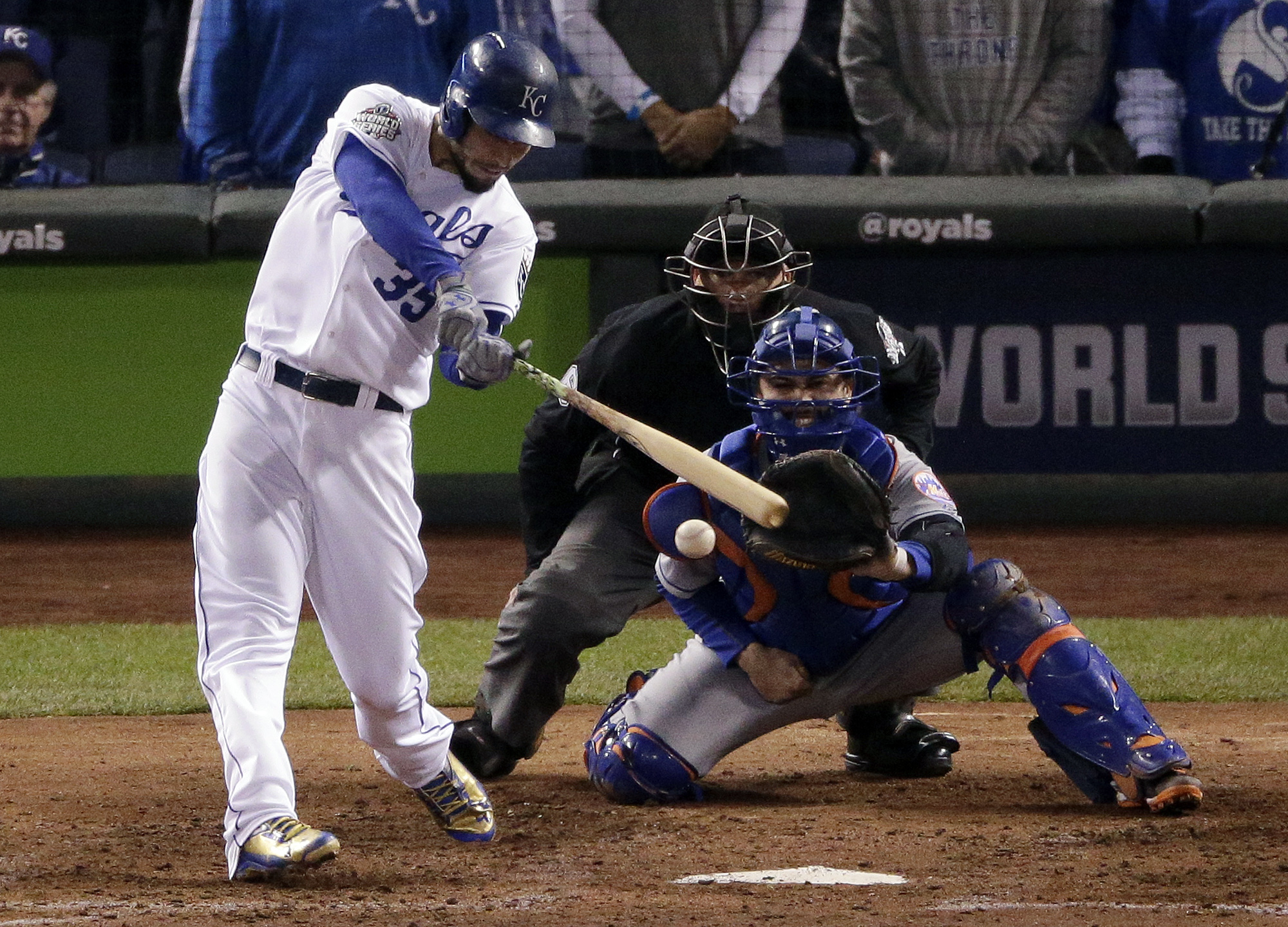 FILE - In this Oct. 28, 2015, file photo, Kansas City Royals' Eric Hosmer hits a two-run single against the New York Mets during the fifth inning of Game 2 of the baseball World Series in Kansas City, Mo. The Royals host the Mets on opening day of the 201