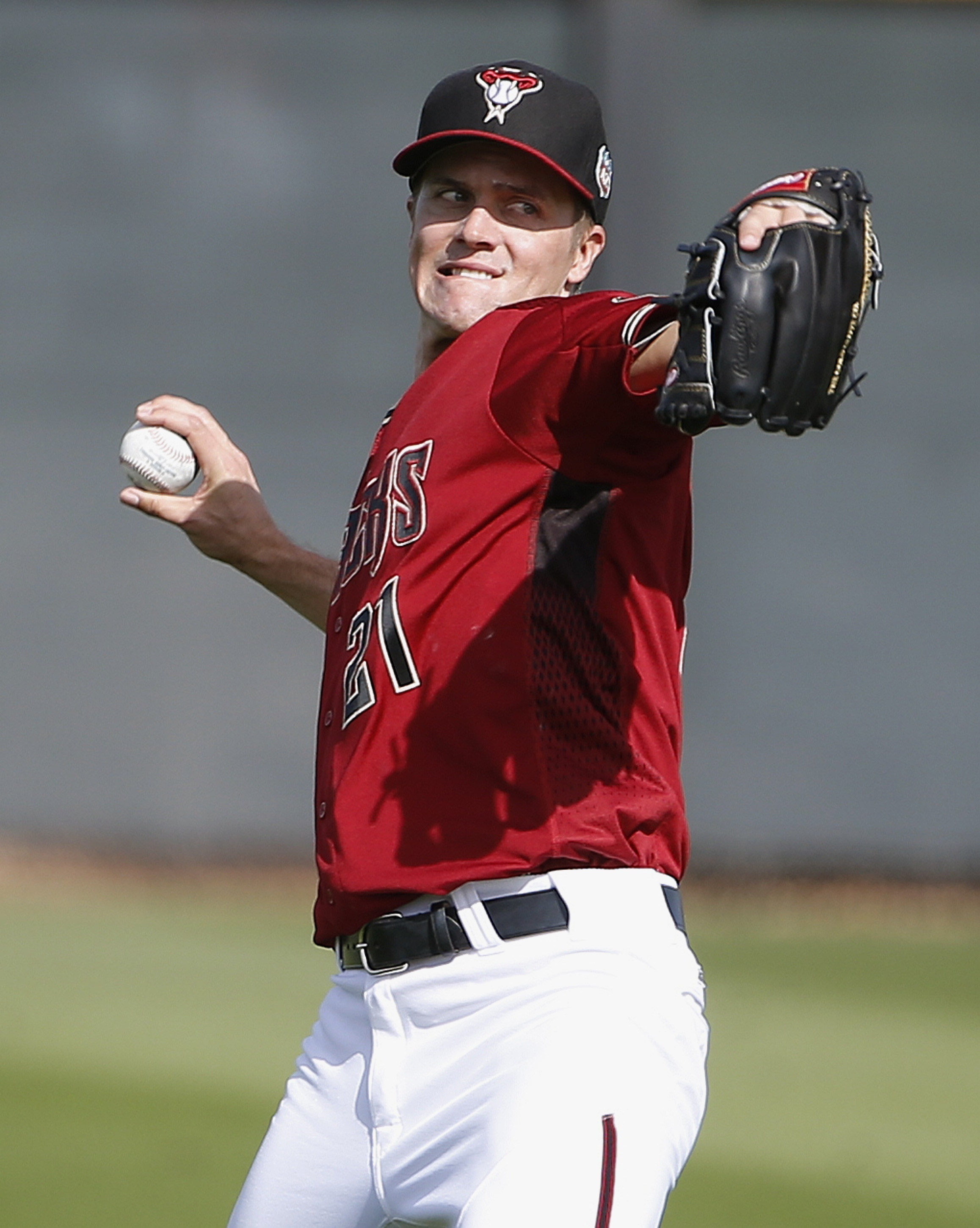 FILE - In this Feb. 29, 2016, file photo, Arizona Diamondbacks' Zack Greinke warms up during a spring training baseball workout in Scottsdale, Ariz. The Diamondbacks face Grenike's former team, the Los Angeles Dodgers, in a series starting July 15. (AP Ph