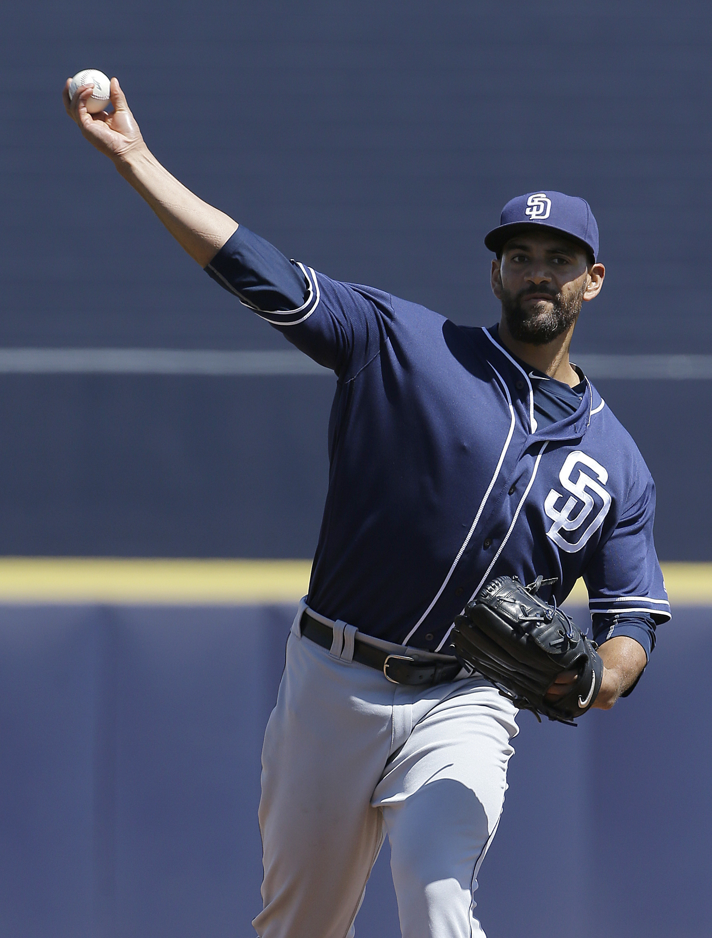 San Diego Padres starting pitcher Tyson Ross throws before the first inning of a spring training baseball game against the Seattle Mariners in Peoria, Ariz., Wednesday, March 30, 2016. (AP Photo/Jeff Chiu)