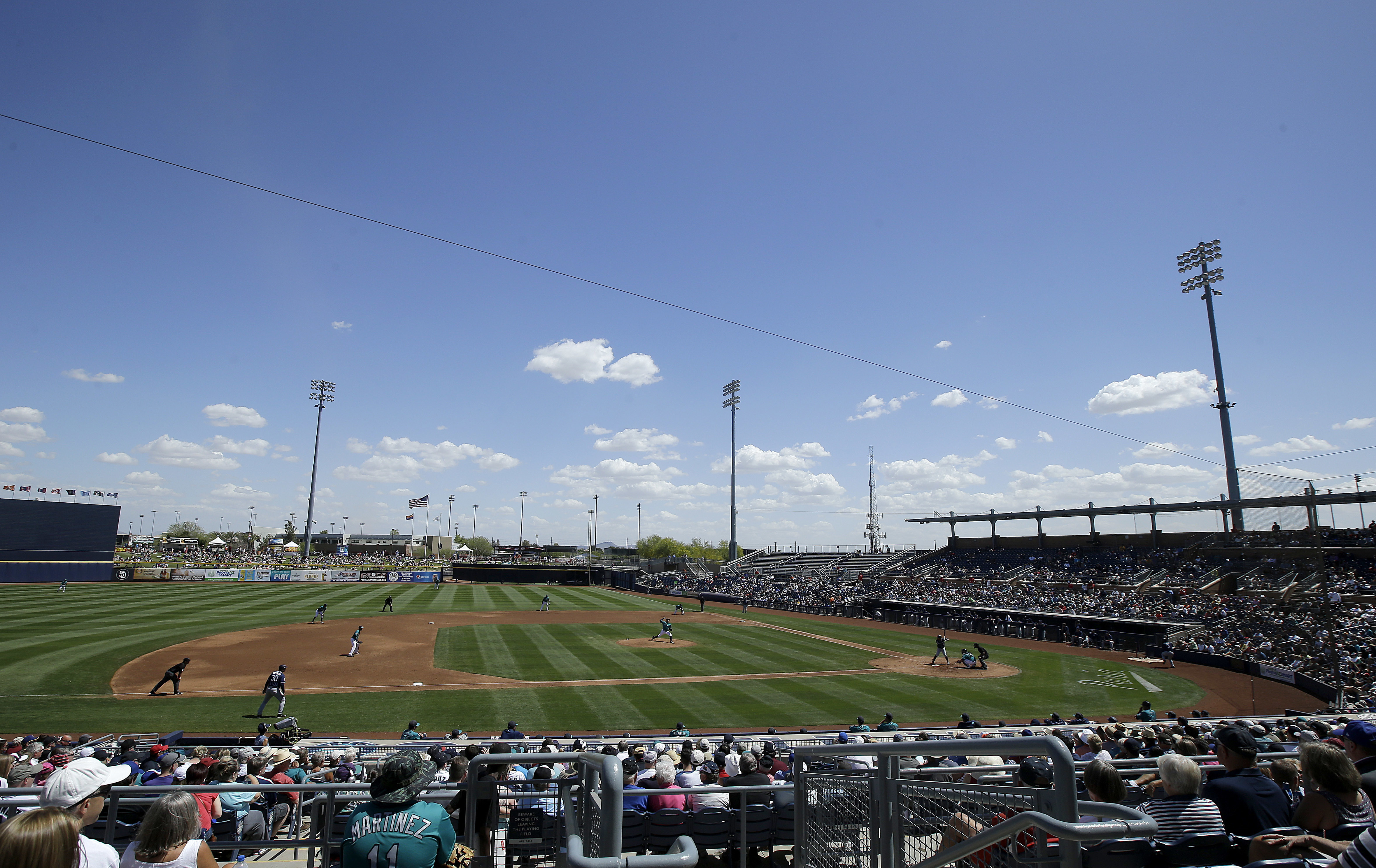 Fans at Peoria Sports Complex watch during the third inning of a spring training baseball game between the Seattle Mariners and the San Diego Padres in Peoria, Ariz., Wednesday, March 30, 2016. (AP Photo/Jeff Chiu)