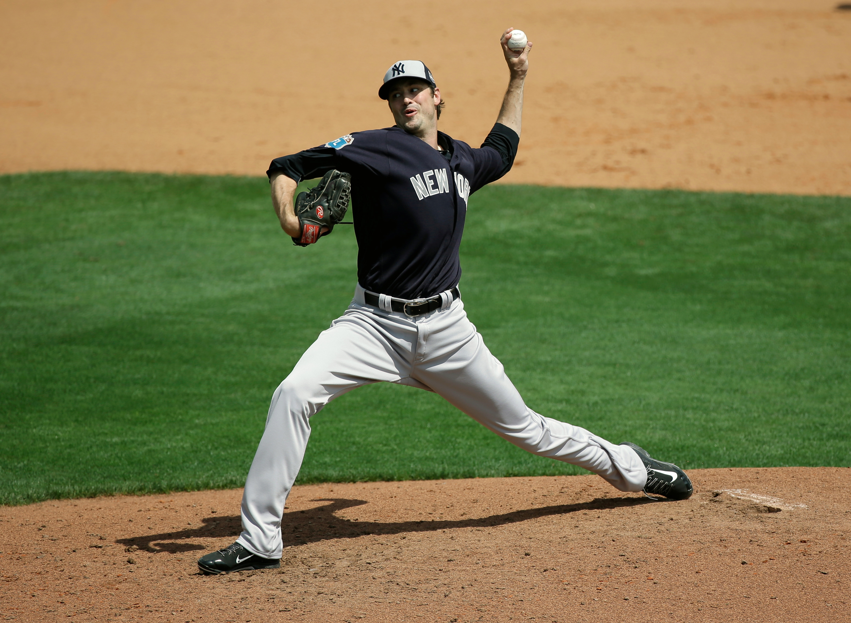 New York Yankees' Andrew Miller pitches against the Atlanta Braves in a spring training baseball game, Wednesday, March 30, 2016, in Kissimmee, Fla. Miller was struck on the right arm by a line drive after the pitch, forcing the left-handed reliever to le