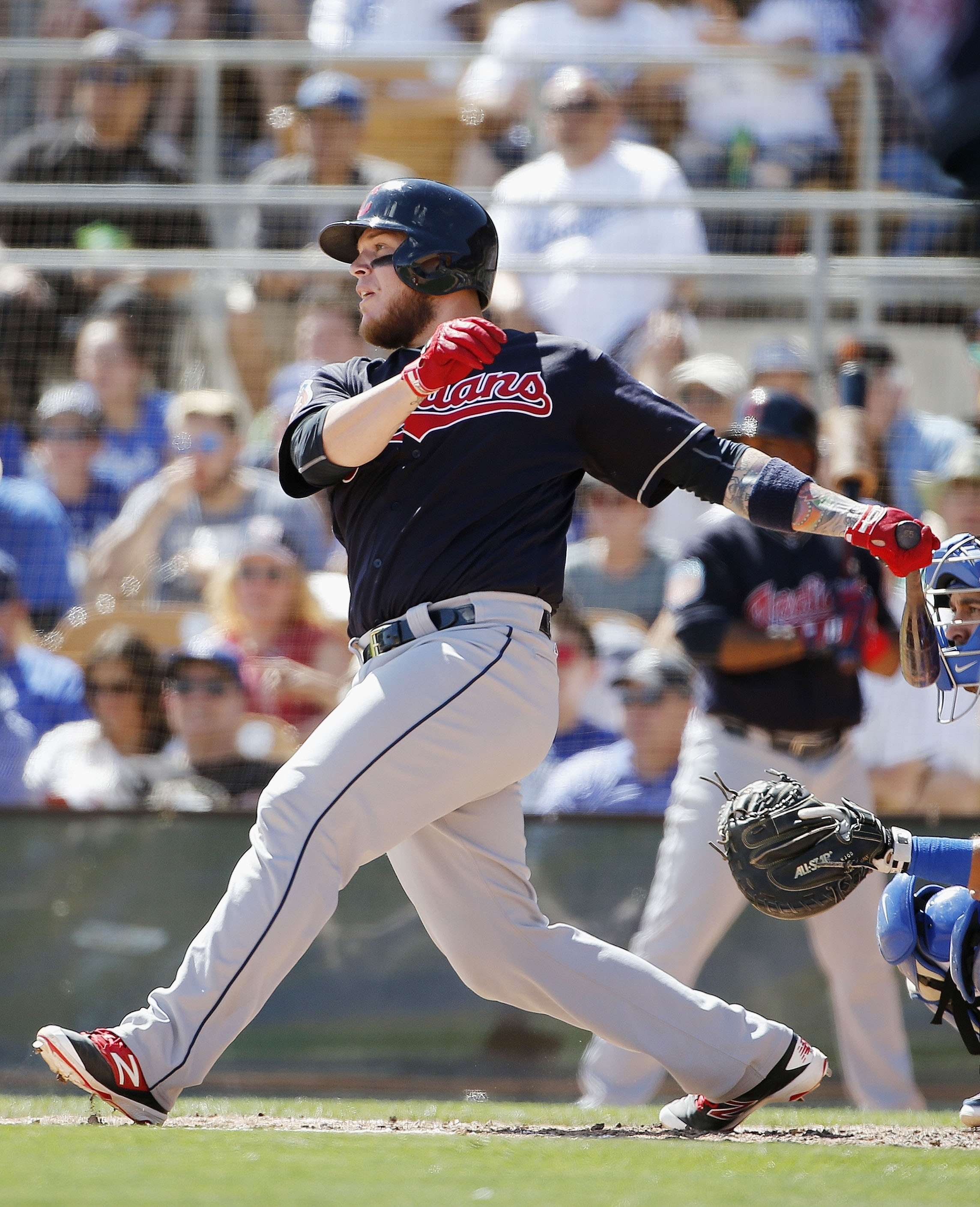 Cleveland Indians' Roberto Perez connects for a run-scoring double against the Los Angeles Dodgers during the fourth inning of a spring training baseball game Wednesday, March 30, 2016, in Glendale, Ariz. The Indians defeated the Dodgers 4-3. (AP Photo/Ro