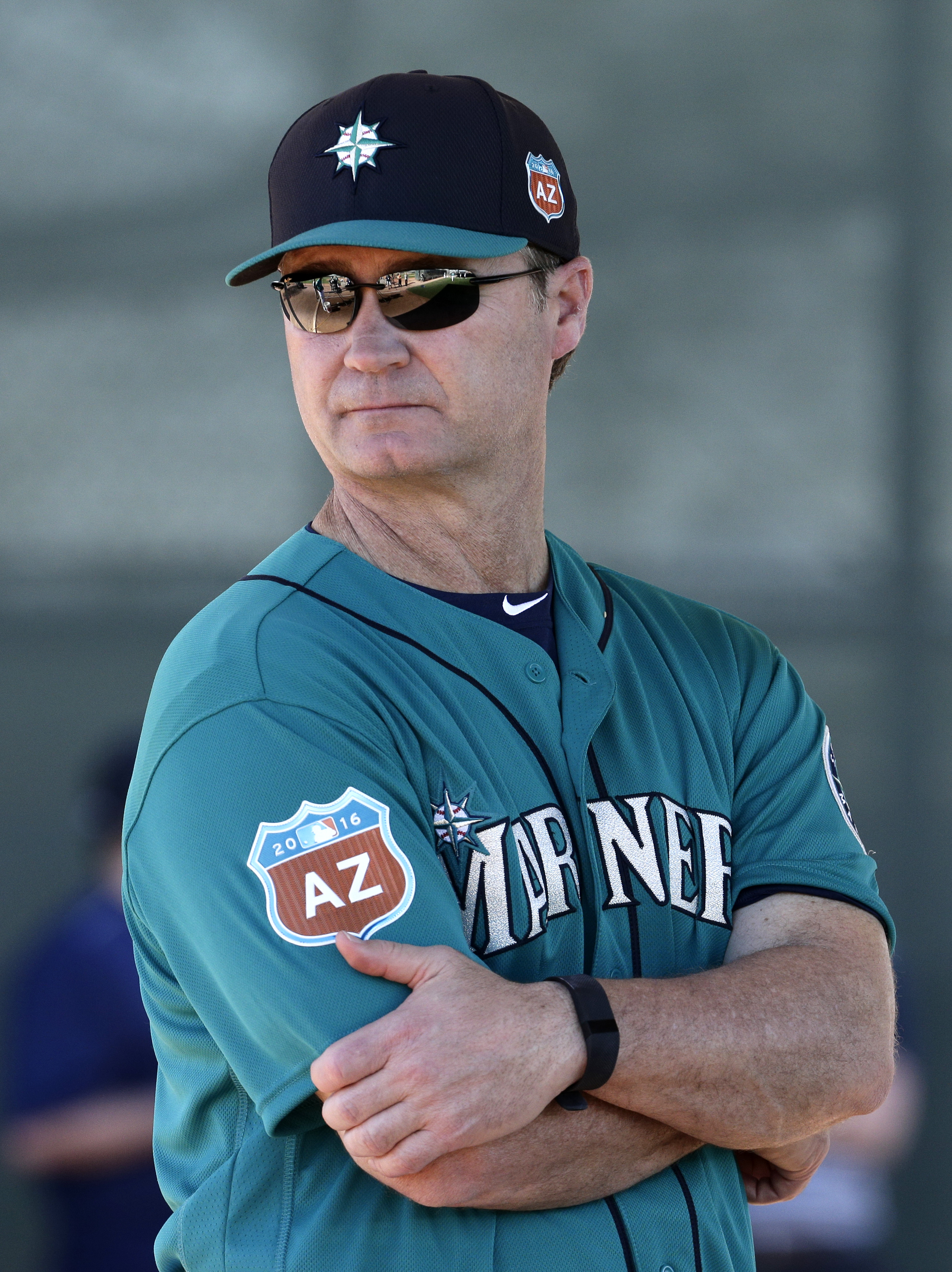 FILE - In this Feb. 20, 2016, file photo, Seattle Mariners manager Scott Servais watches a drill during spring training baseball practice, in Peoria, Ariz. From the chair of new general manager Jerry Dipoto, to first-time manager Scott Servais and down to