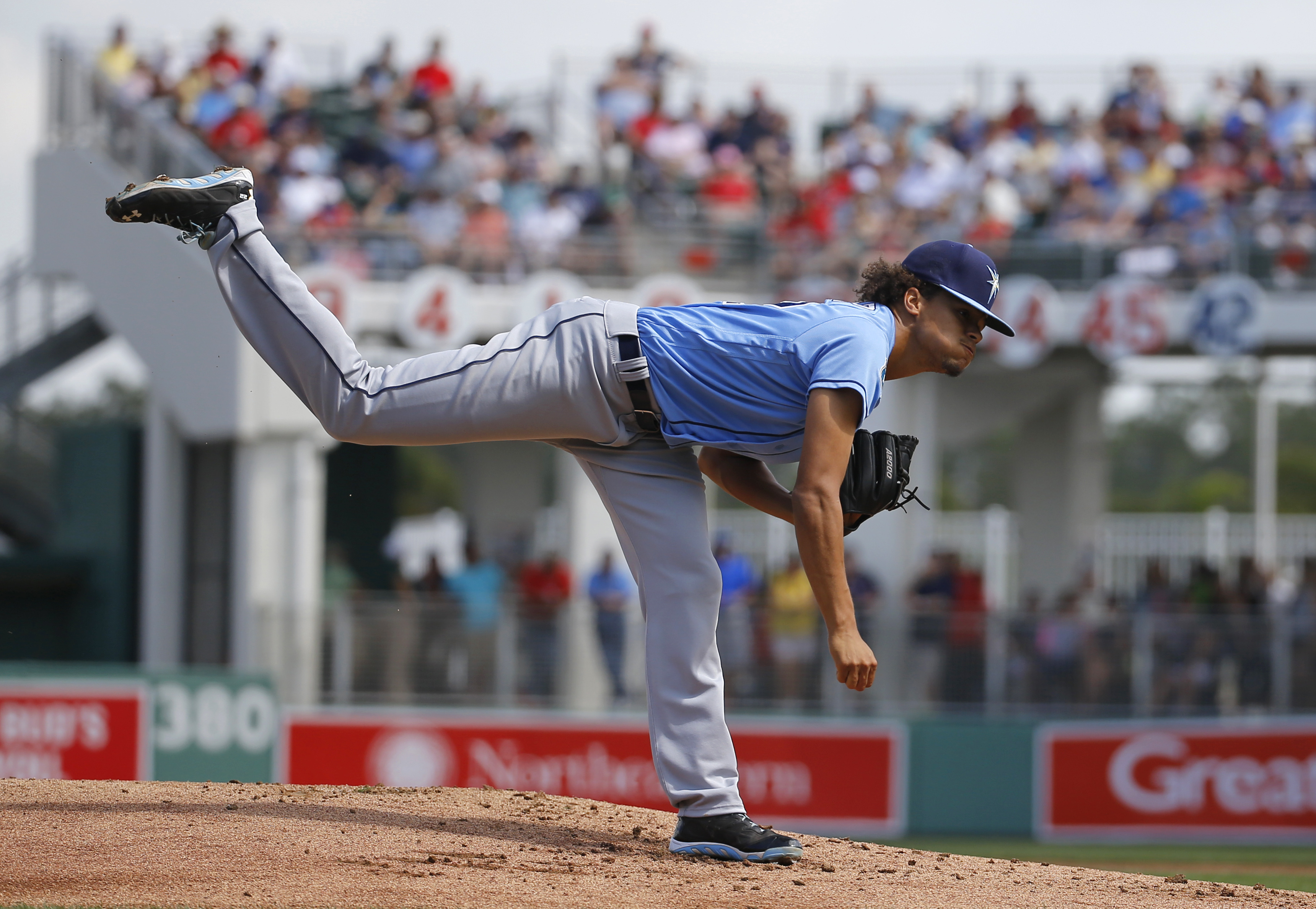 FILE - In this March 4, 2016, file photo, Tampa Bay Rays starting pitcher Chris Archer follows through on a pitch to the Boston Red Sox in the first inning of a spring training baseball game in Fort Myers, Fla. From a pitching rotation that has the potent