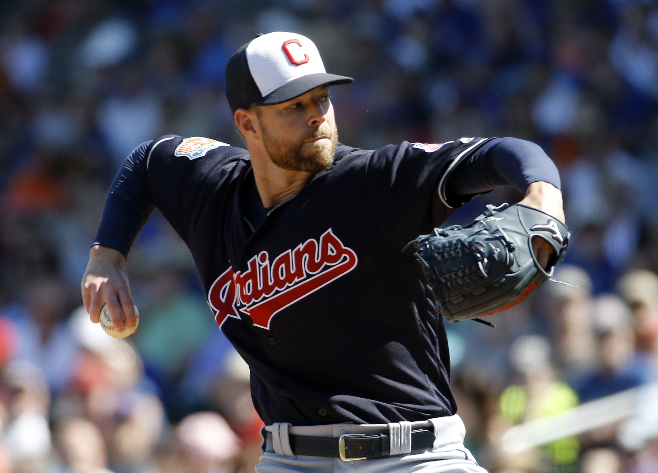 FILE - This March 9, 2016 file photo shows Cleveland Indians' Corey Kluber throwing during the first inning of a spring training baseball game against the Chicago Cubs, in Mesa, Ariz. They've got perhaps baseball's deepest rotation, one of its finest mana