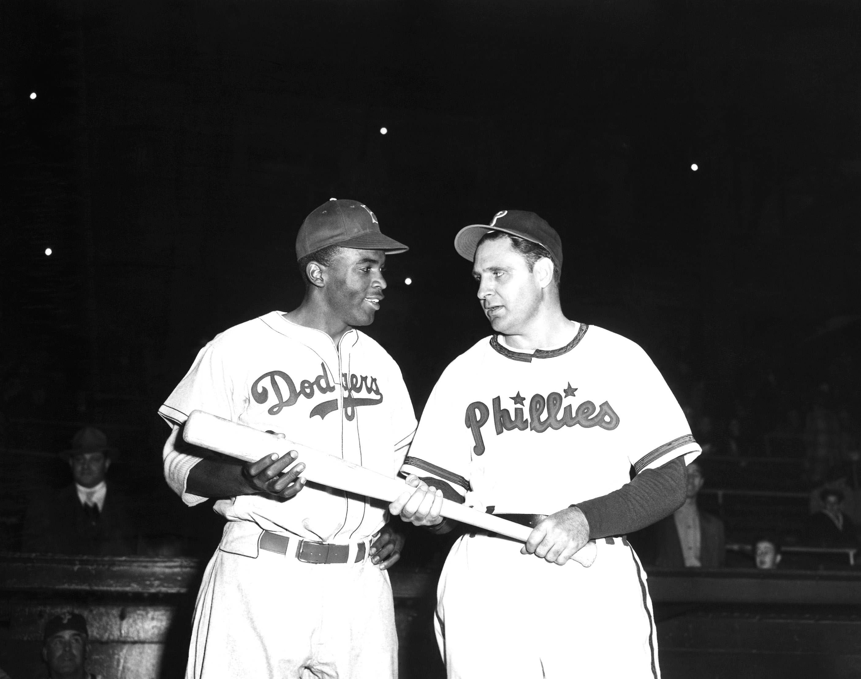 FILE - In a May 9, 1947 file photo, Jackie Robinson, left, Brooklyn Dodgers' first baseman, looks over the bat Philadelphia Phillies manager Ben Chapman uses during practice, as he prepared to play his first Philadelphia game for the Dodgers. The Philadel