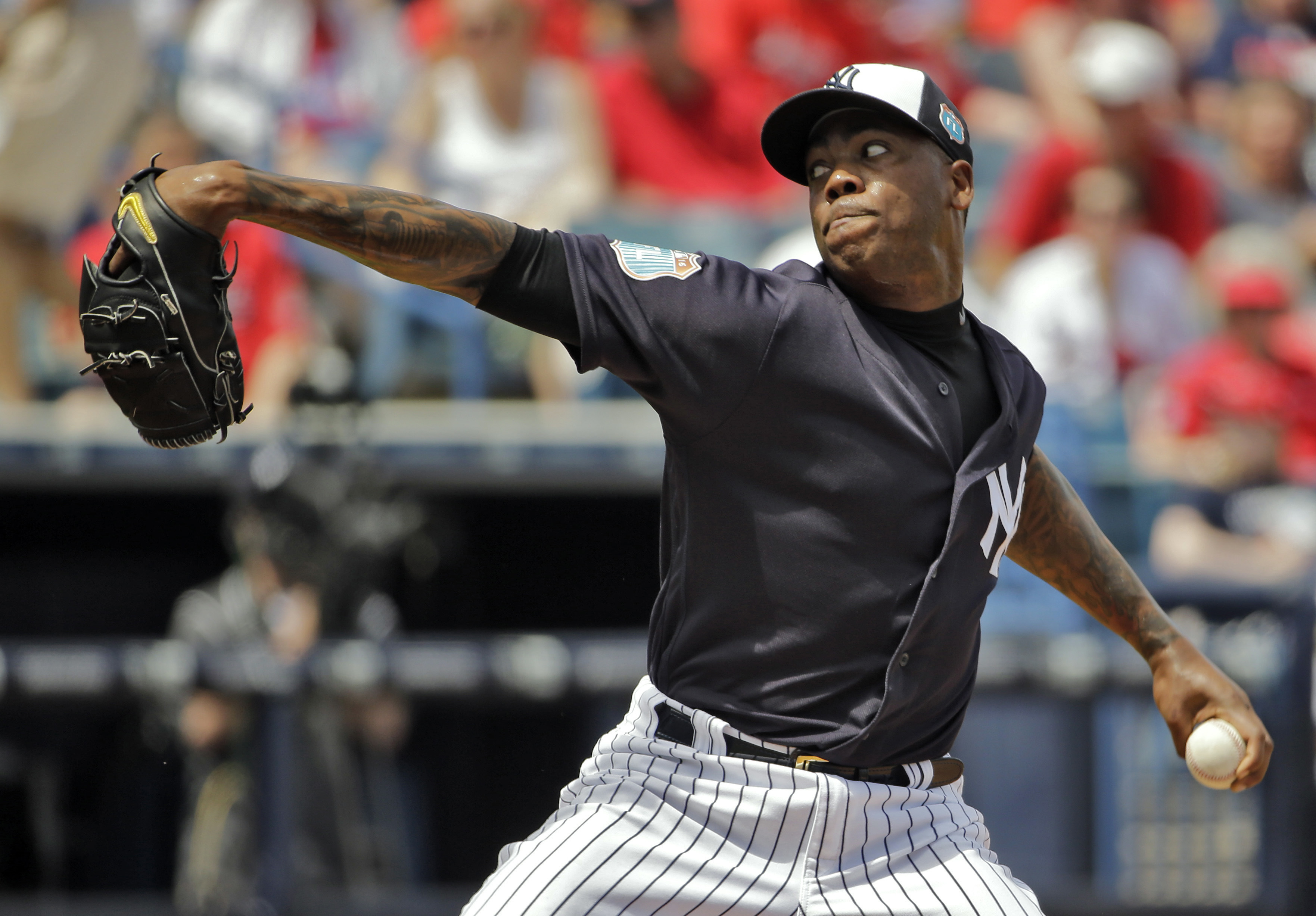 New York Yankees' Aroldis Chapman pitches to the St. Louis Cardinals during the sixth inning of a spring training baseball game Thursday, March 31, 2016, in Tampa, Fla. (AP Photo/Chris O'Meara)