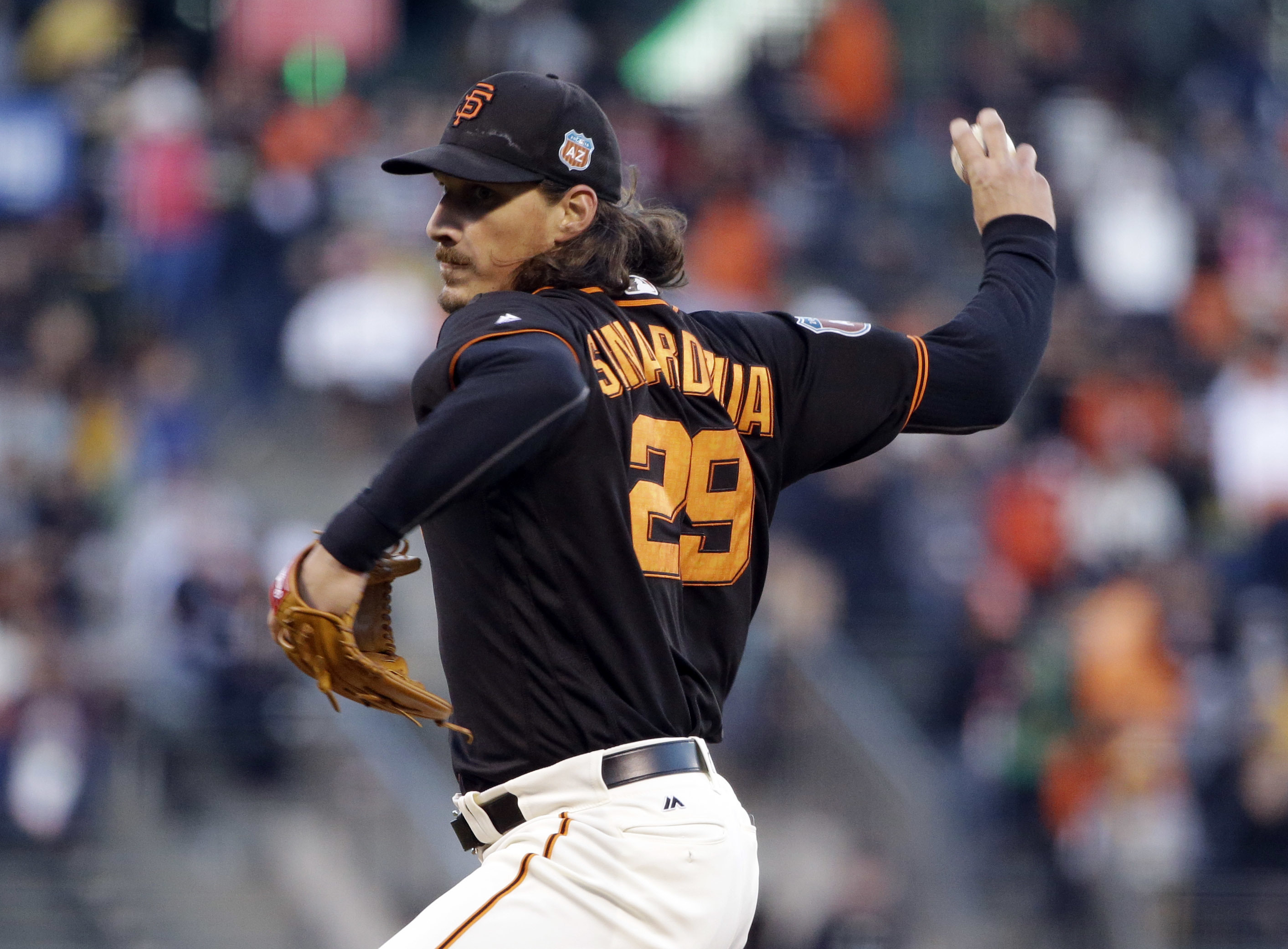 San Francisco Giants starting pitcher Jeff Samardzija throws to the Oakland Athletics during the first inning of an exhibition baseball game Thursday, March 31, 2016, in San Francisco. (AP Photo/Marcio Jose Sanchez)