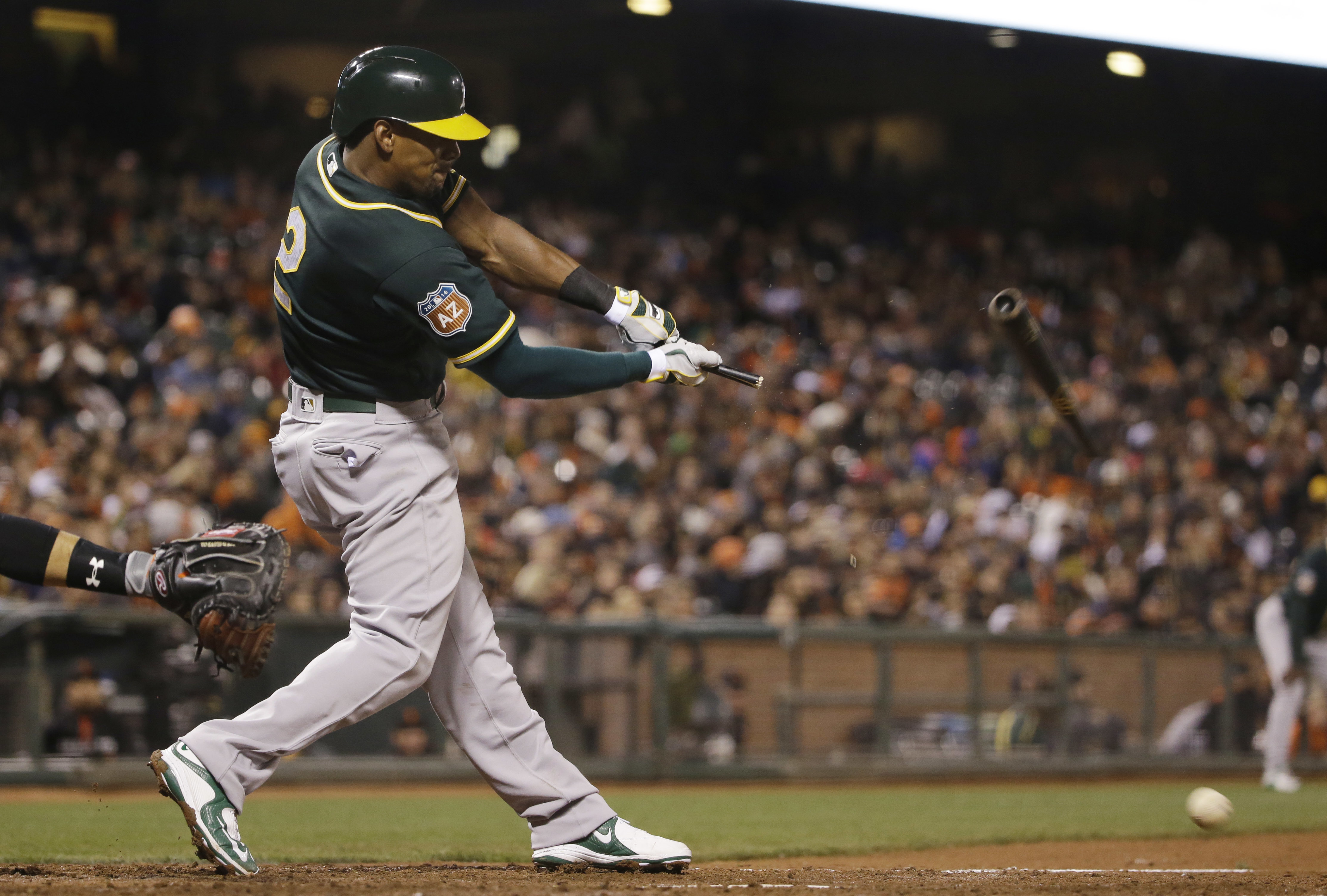 Oakland Athletics' Khris Davis breaks his bat as he grounds out against the San Francisco Giants during the seventh inning of an exhibition baseball game Thursday, March 31, 2016, in San Francisco.(AP Photo/Marcio Jose Sanchez)