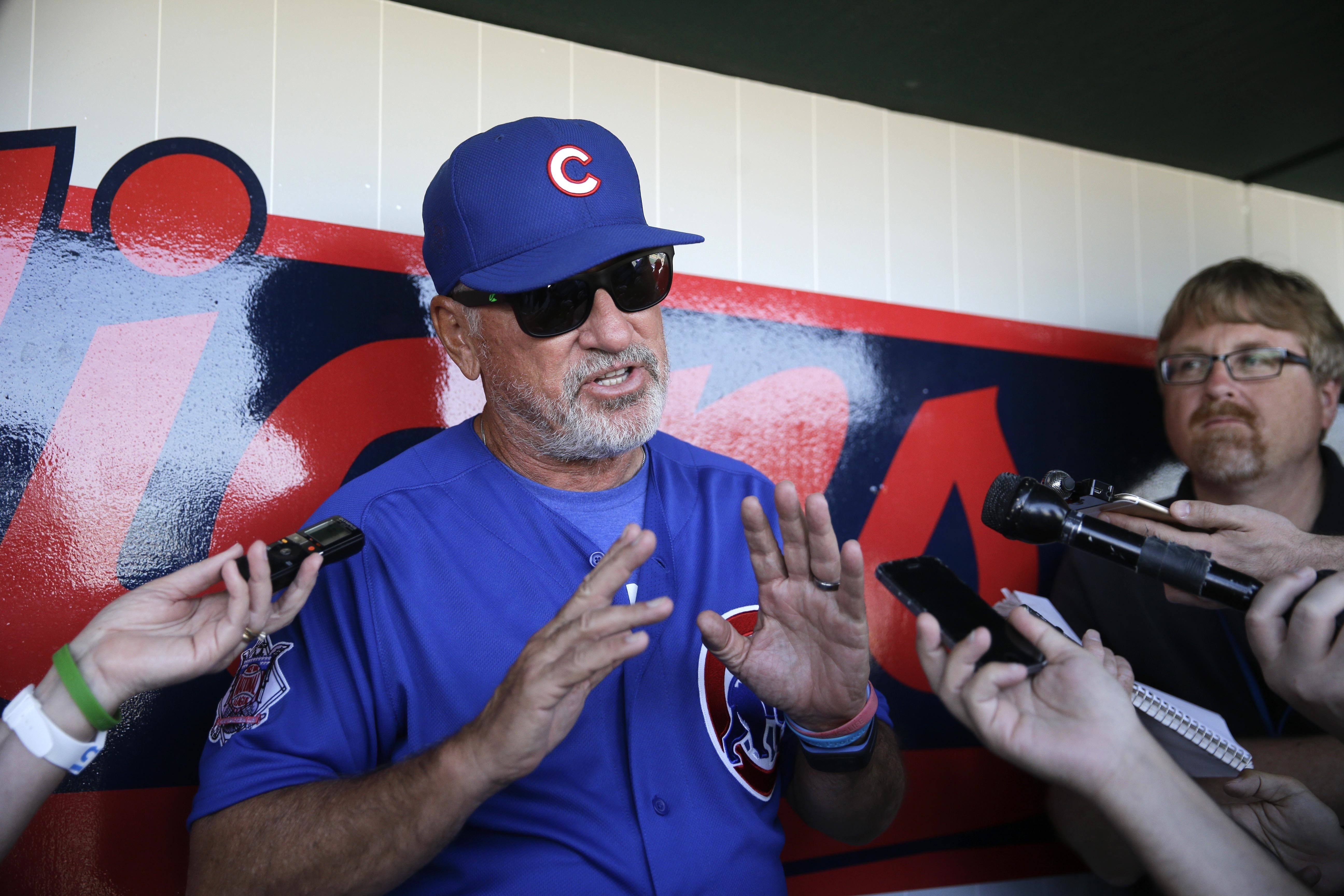 FILE - In this March 22, 2016 file photo, Chicago Cubs manager Joe Maddon smiles while talking to reporters before a spring training baseball game in Goodyear, Ariz. The Cubs open at the Los Angeles Angels on Monday night April 4, 2016, eyeing another big