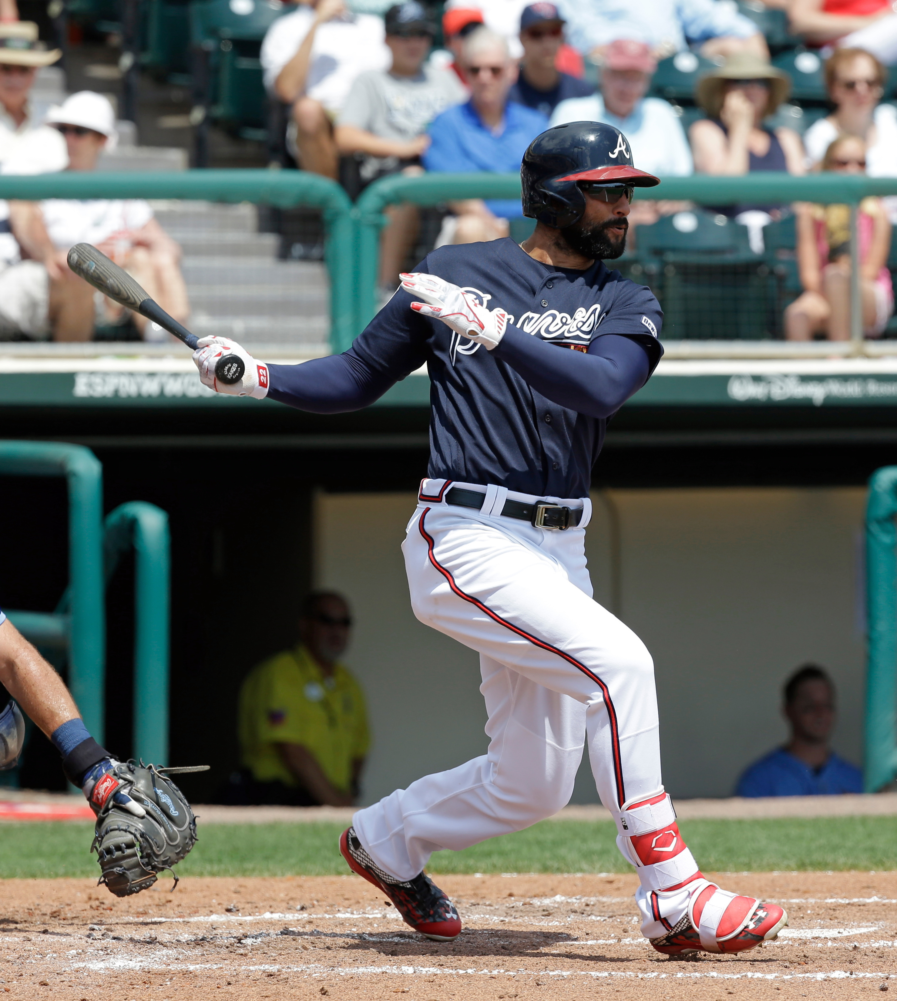 Atlanta Braves' Nick Markakis gets a base hit against the Tampa Bay Rays in the fourth inning of a spring training baseball game, Friday, April 1, 2016, in Kissimmee, Fla. (AP Photo/John Raoux)
