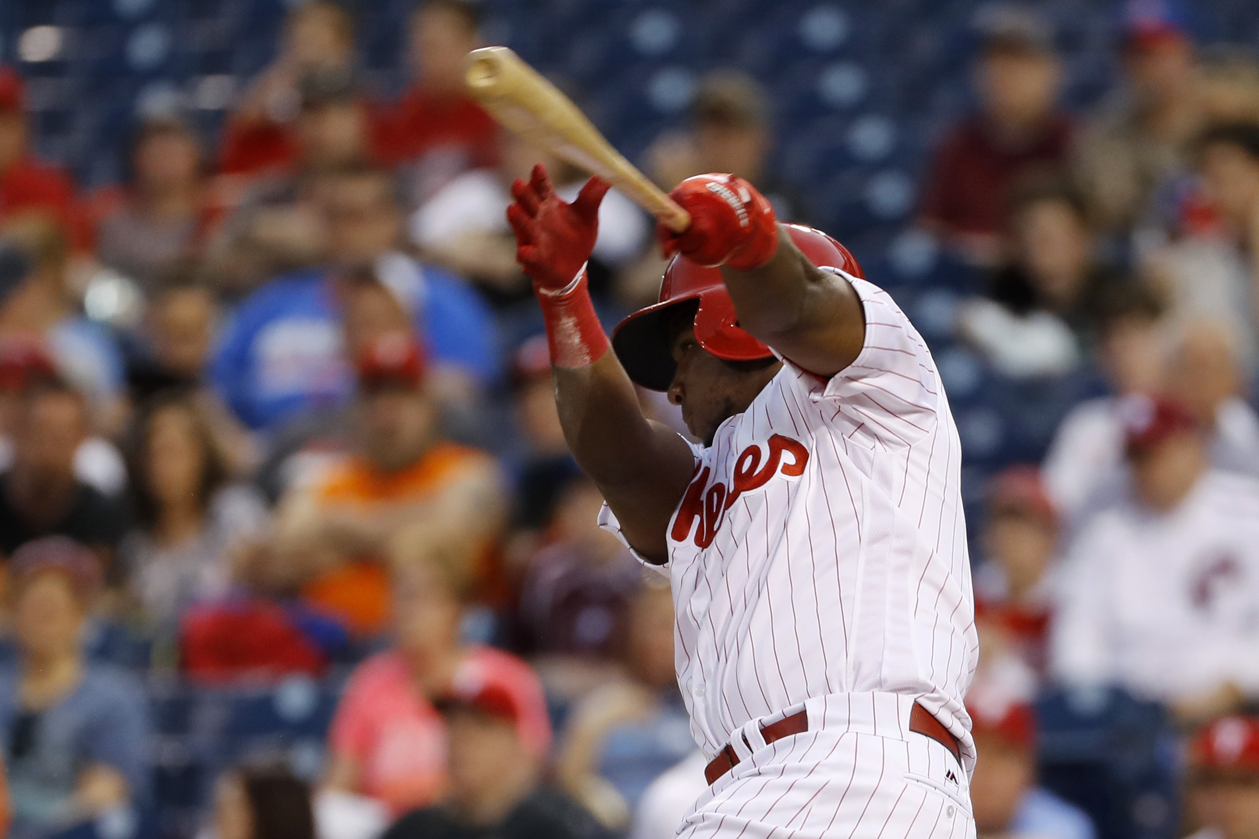 Philadelphia Phillies' Maikel Franco follows through after hitting a run-scoring fielder's choice off Baltimore Orioles pitcher Vance Worley during the first inning of an exhibition baseball game, Friday, April 1, 2016, in Philadelphia. (AP Photo/Matt Slo