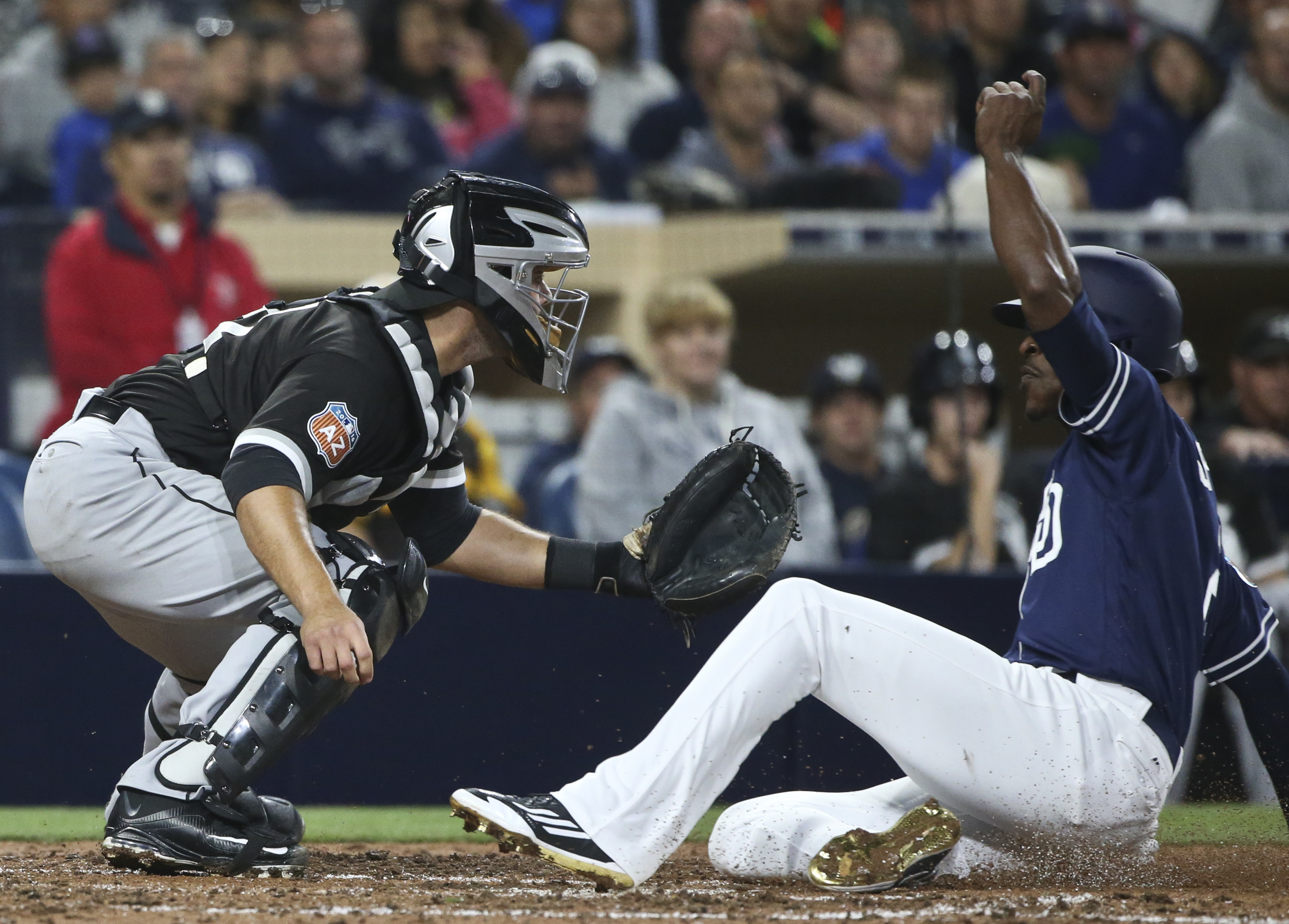 San Diego Padres' Mevin Upton Jr. beats the throw to Chicago White Sox catcher Alex Avila while scoring from third on a sacrifice fly during the sixth inning of an exhibition baseball game Friday, April 1, 2016, in San Diego. (AP Photo/Lenny Ignelzi)