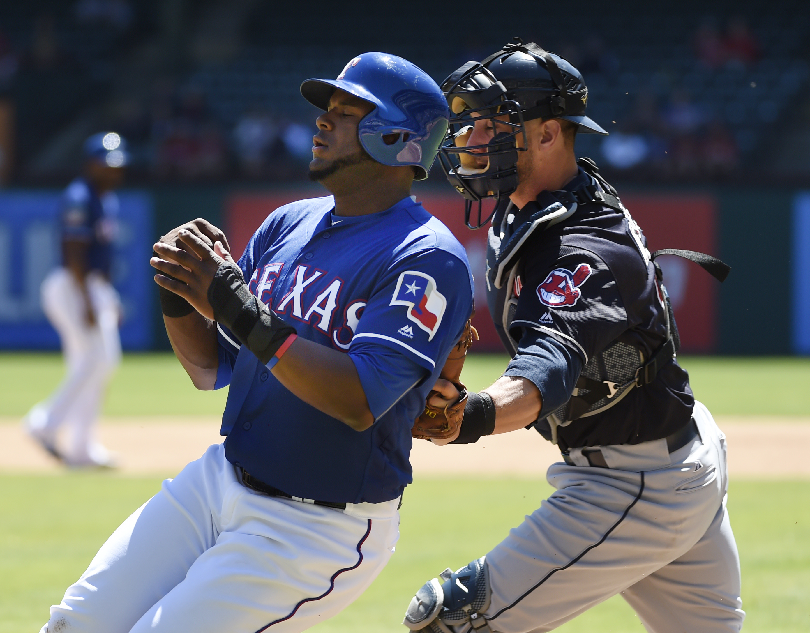 Texas Rangers second baseman Hanser Alberto (2) is tagged out by Cleveland Indians catcher Yan Gomes (10) on a rundown to complete a double play during the second inning of their exhibition baseball game in Arlington, Texas, on Saturday, April 2, 2016. (A