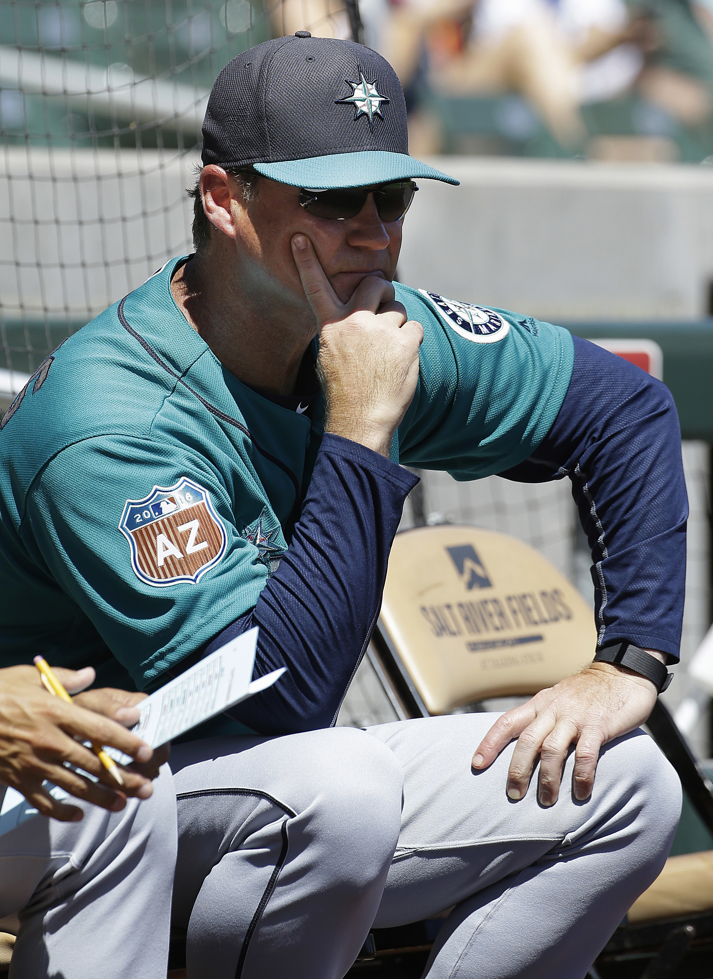 Seattle Mariners manager Scott Servais watches from field level in the first inning of a spring training baseball game against the Colorado Rockies in Scottsdale, Ariz., Saturday, April 2, 2016. (AP Photo/Jeff Chiu)
