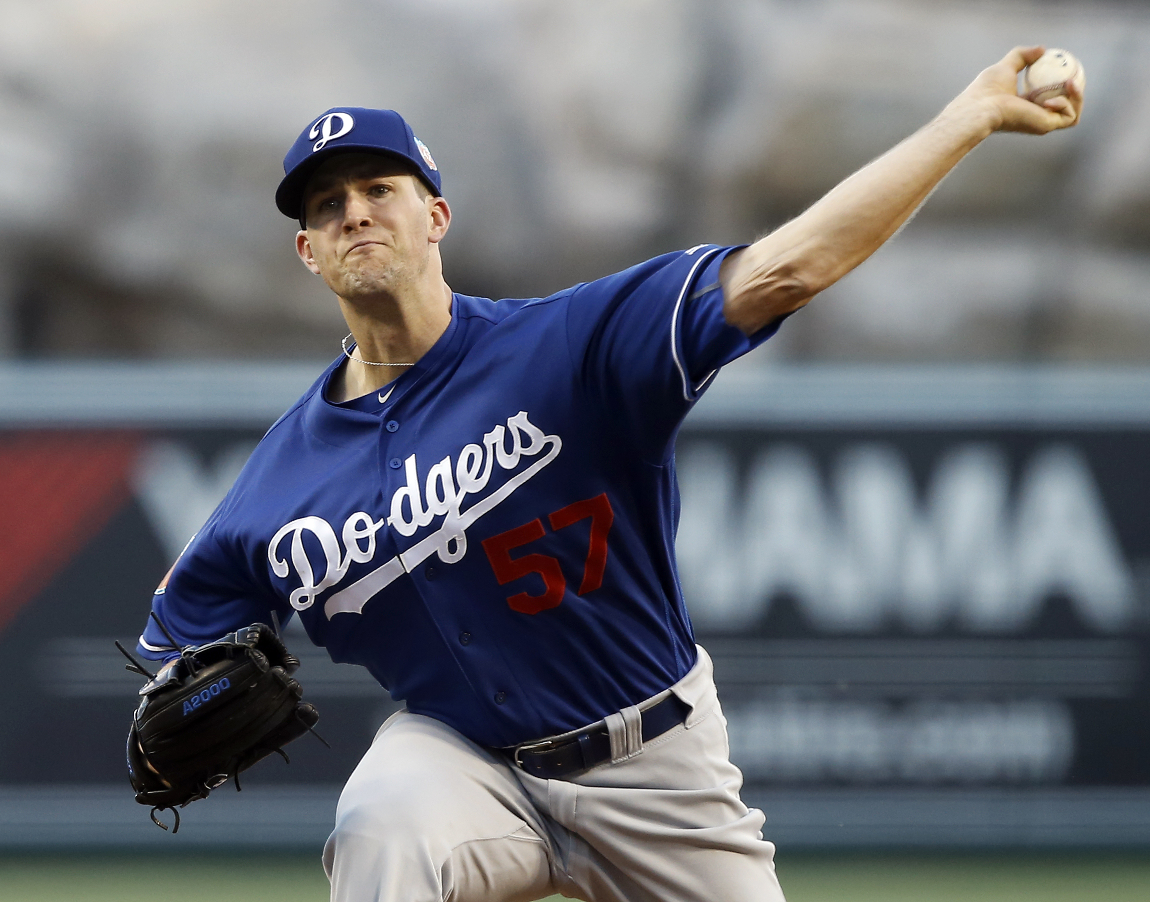Los Angeles Dodgers starting pitcher Alex Wood throws against the Los Angeles Angels during the first inning of an exhibition baseball game in Anaheim, Calif., Saturday, April 2, 2016. (AP Photo/Alex Gallardo)