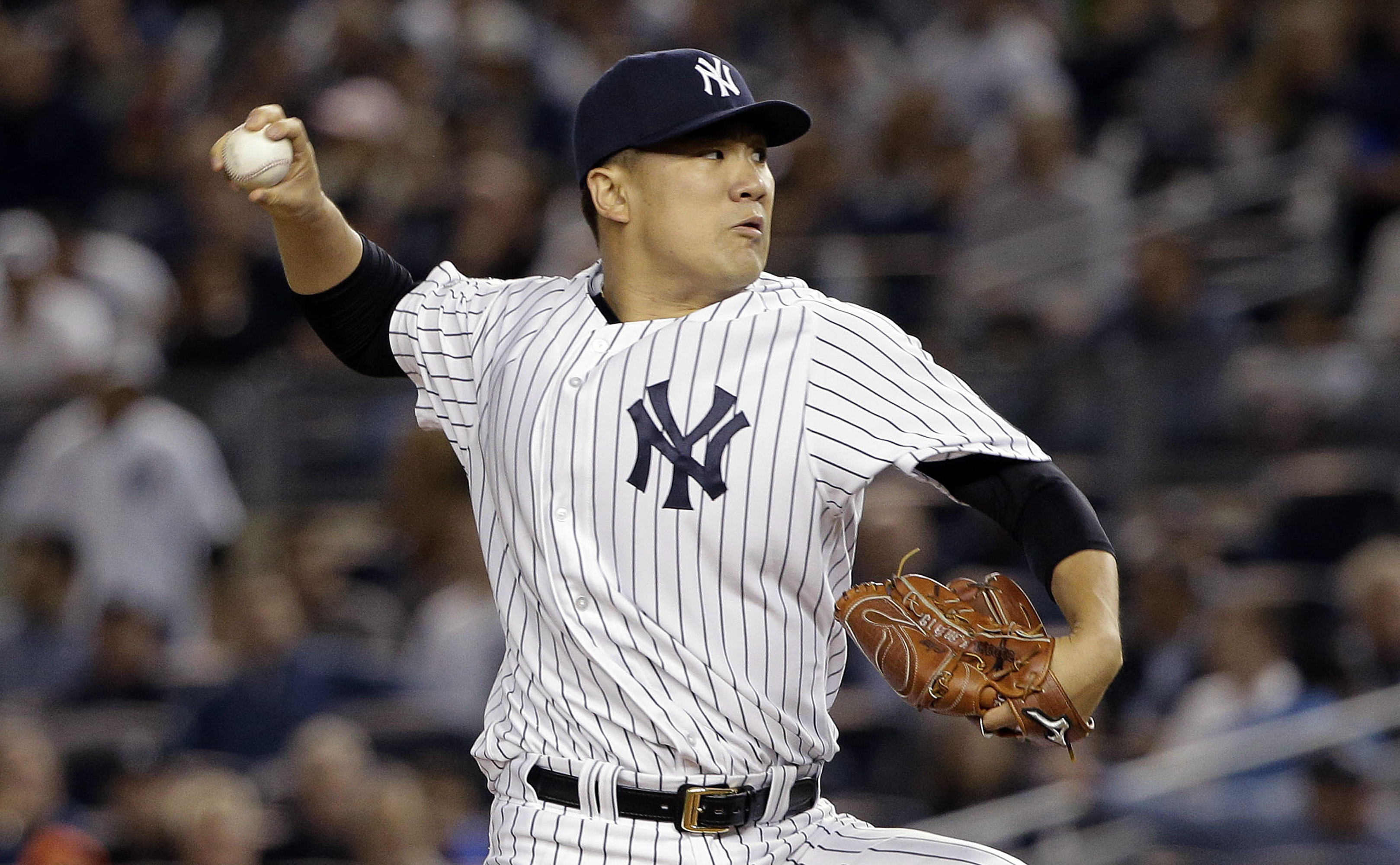 FILE - In this Tuesday, Oct. 6, 2015, file photo, New York Yankees pitcher Masahiro Tanaka delivers against the Houston Astros during the first inning of the American League wild card baseball game in New York. When Dallas Keuchel last took the mound at Y