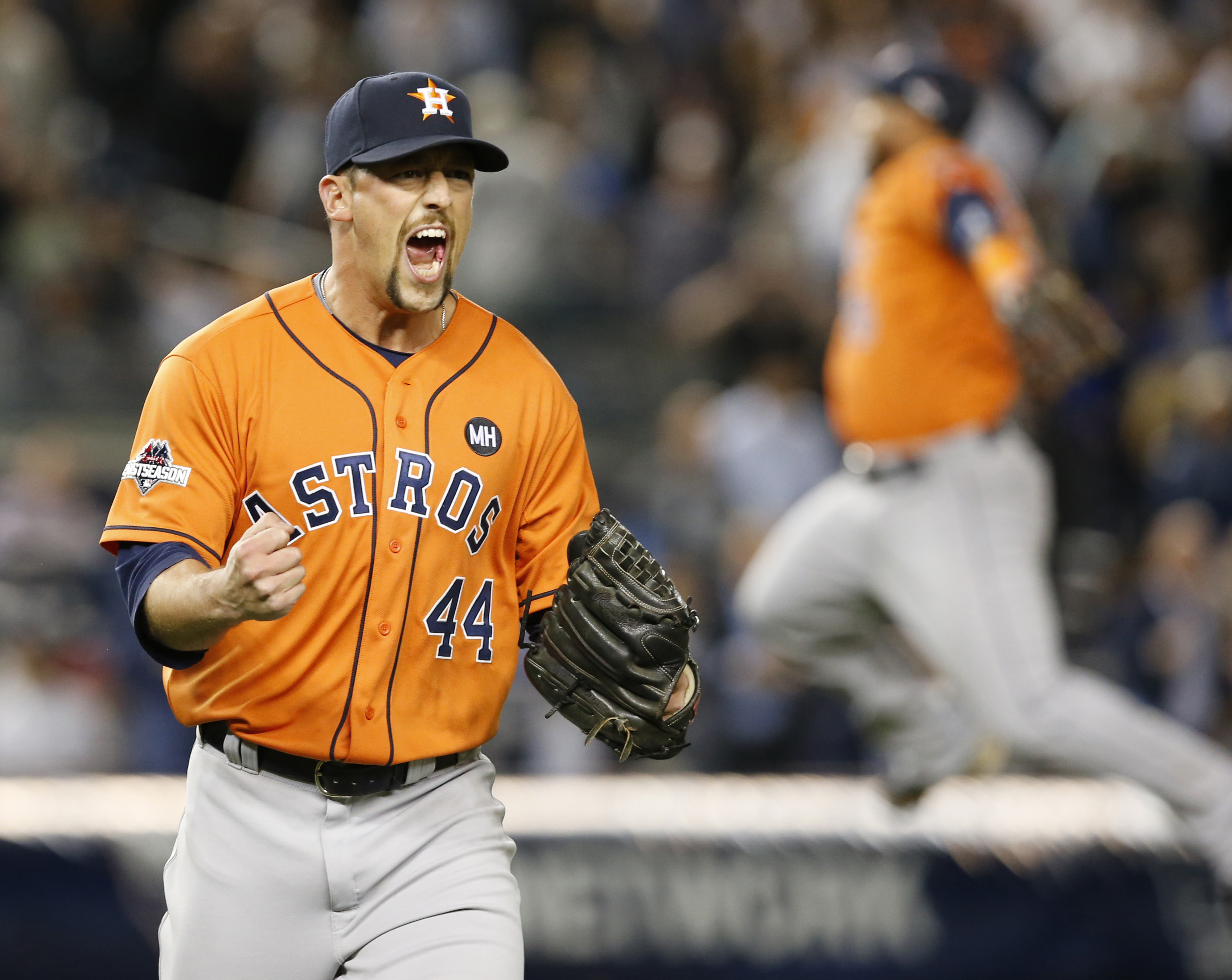 FILE - In this Oct. 6, 2015, file photo, Houston Astros relief pitcher Luke Gregerson (44) reacts as a fellow teammate leaps in the air at the final out of the Astros 3-0 shutout of the New York Yankees in the American League wild card baseball game at Ya
