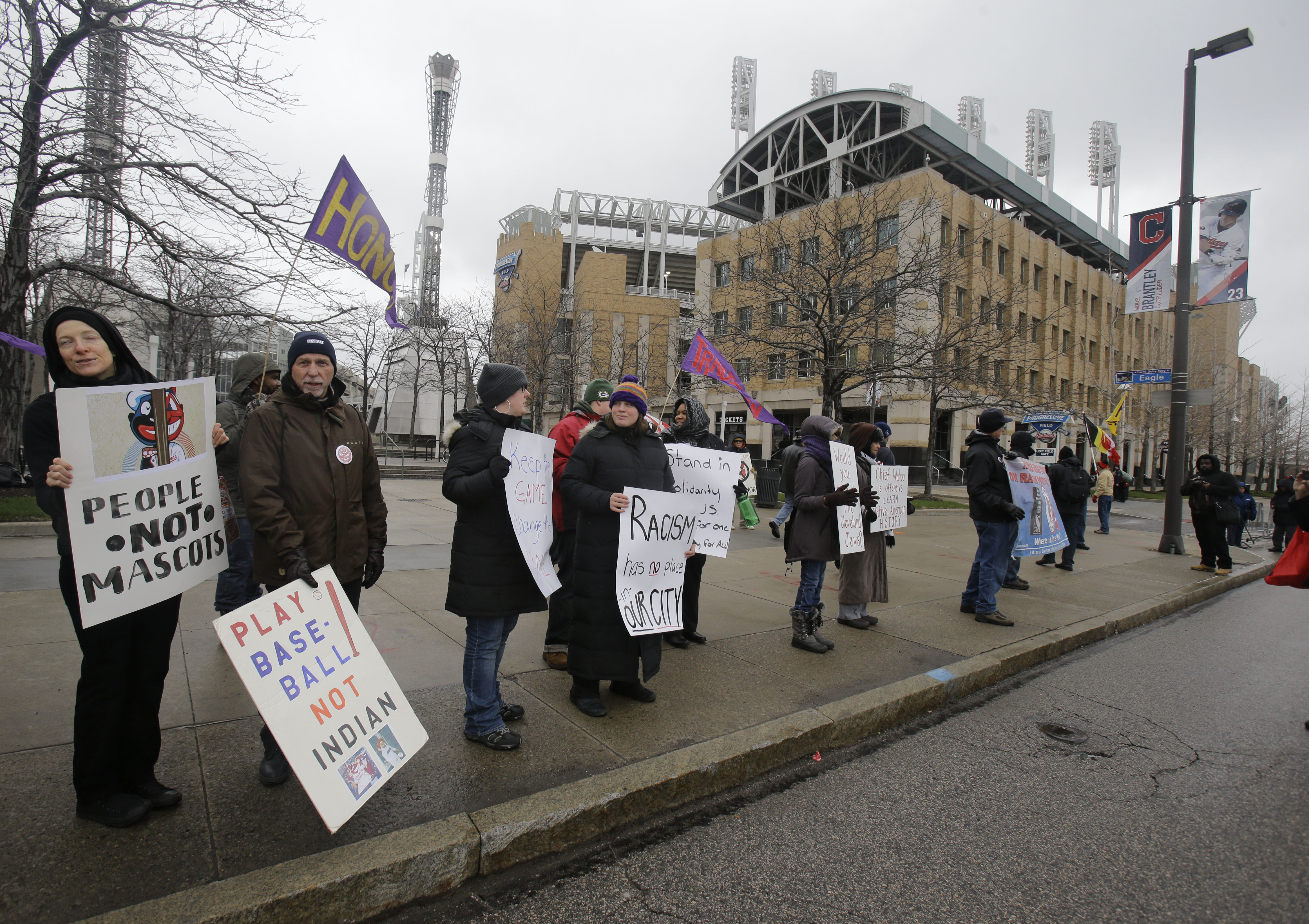 Protesters gather outside Progressive Field to protest the Cleveland Indians mascot before a baseball postponed game between the Boston Red Sox and the Cleveland Indians, Monday, April 4, 2016, in Cleveland. (AP Photo/Tony Dejak)