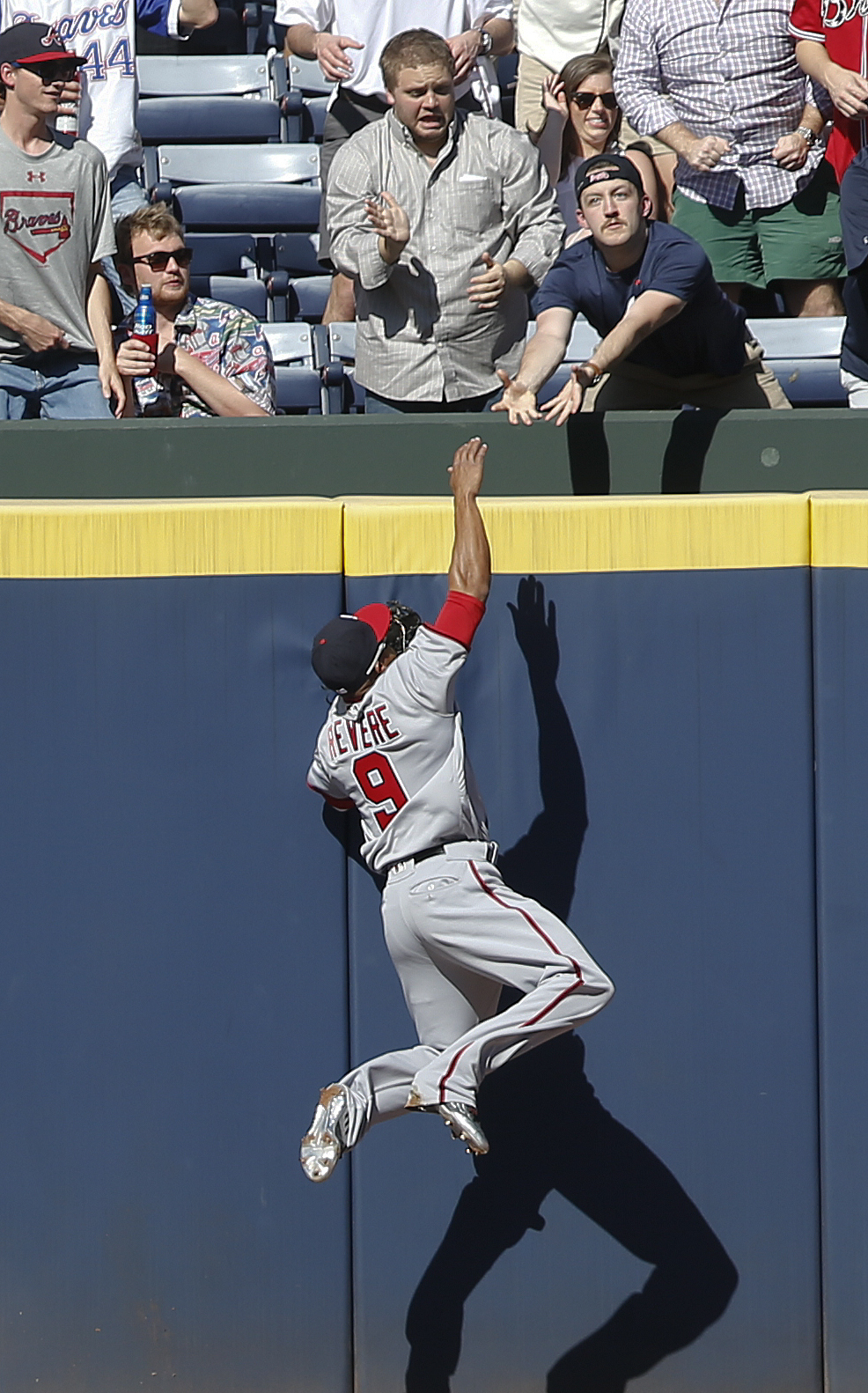 Washington Nationals center fielder Ben Revere (9) fails to reach a ball hit for a home run by Atlanta Braves' Freddie Freeman (5) in the firs tinning of a baseball game Monday, April 4, 2016, in Atlanta. (AP Photo/John Bazemore)