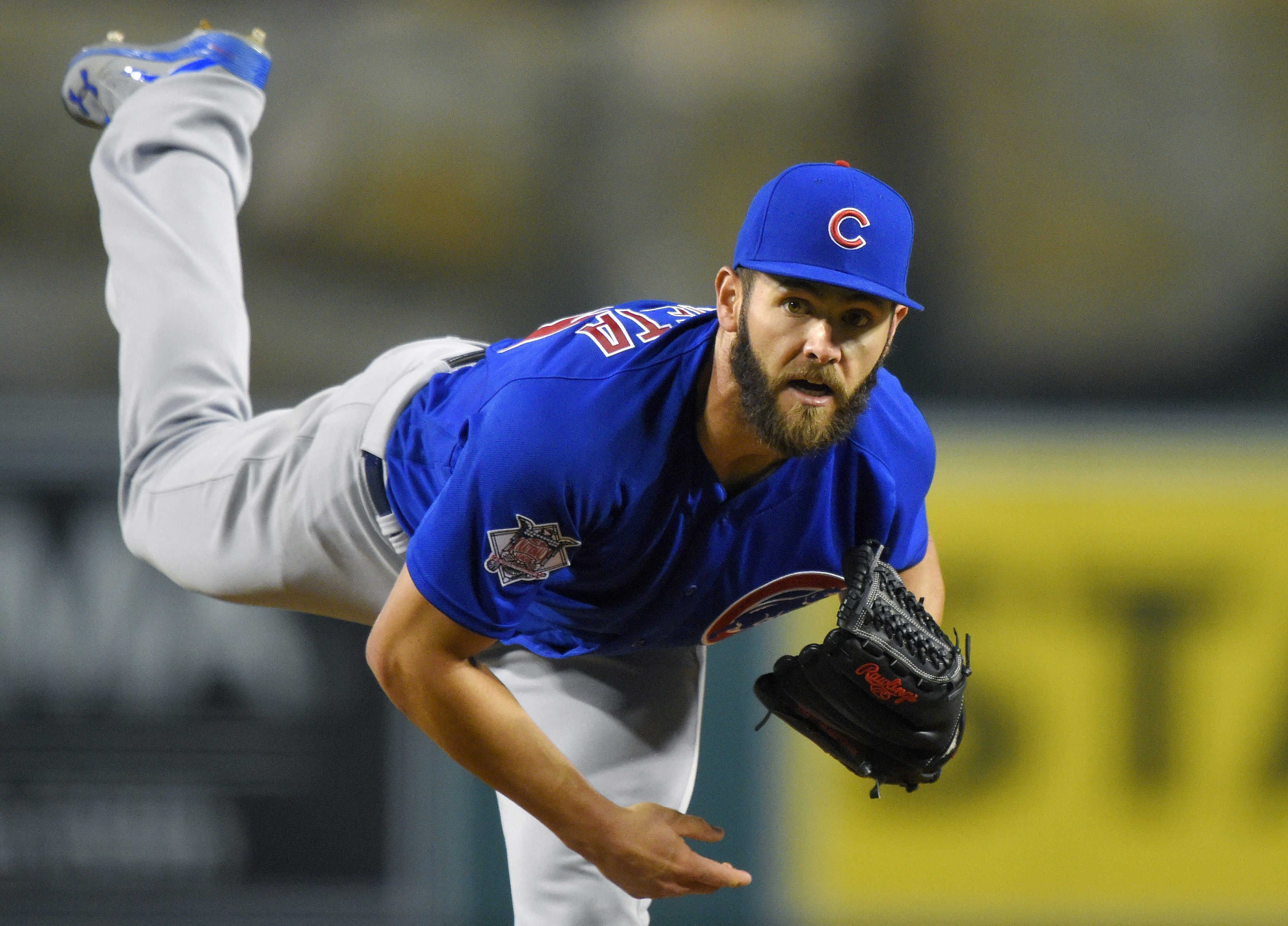 Chicago Cubs starting pitcher Jake Arrieta throws to the plate during the second inning of an opening day baseball game against the Los Angeles Angels, Monday, April 4, 2016, in Anaheim, Calif. (AP Photo/Mark J. Terrill)