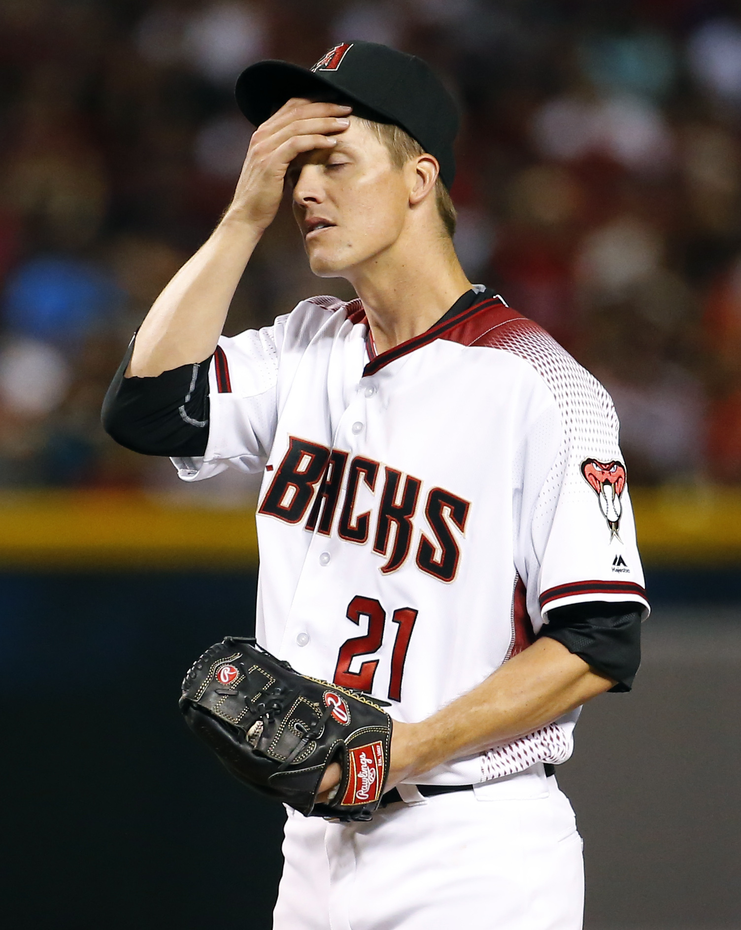 Arizona Diamondbacks starting pitcher Zack Greinke (21) reacts to giving up a home run against the Colorado Rockies during the fourth inning of a baseball game, Monday, April 4, 2016, in Phoenix. (AP Photo/Matt York)