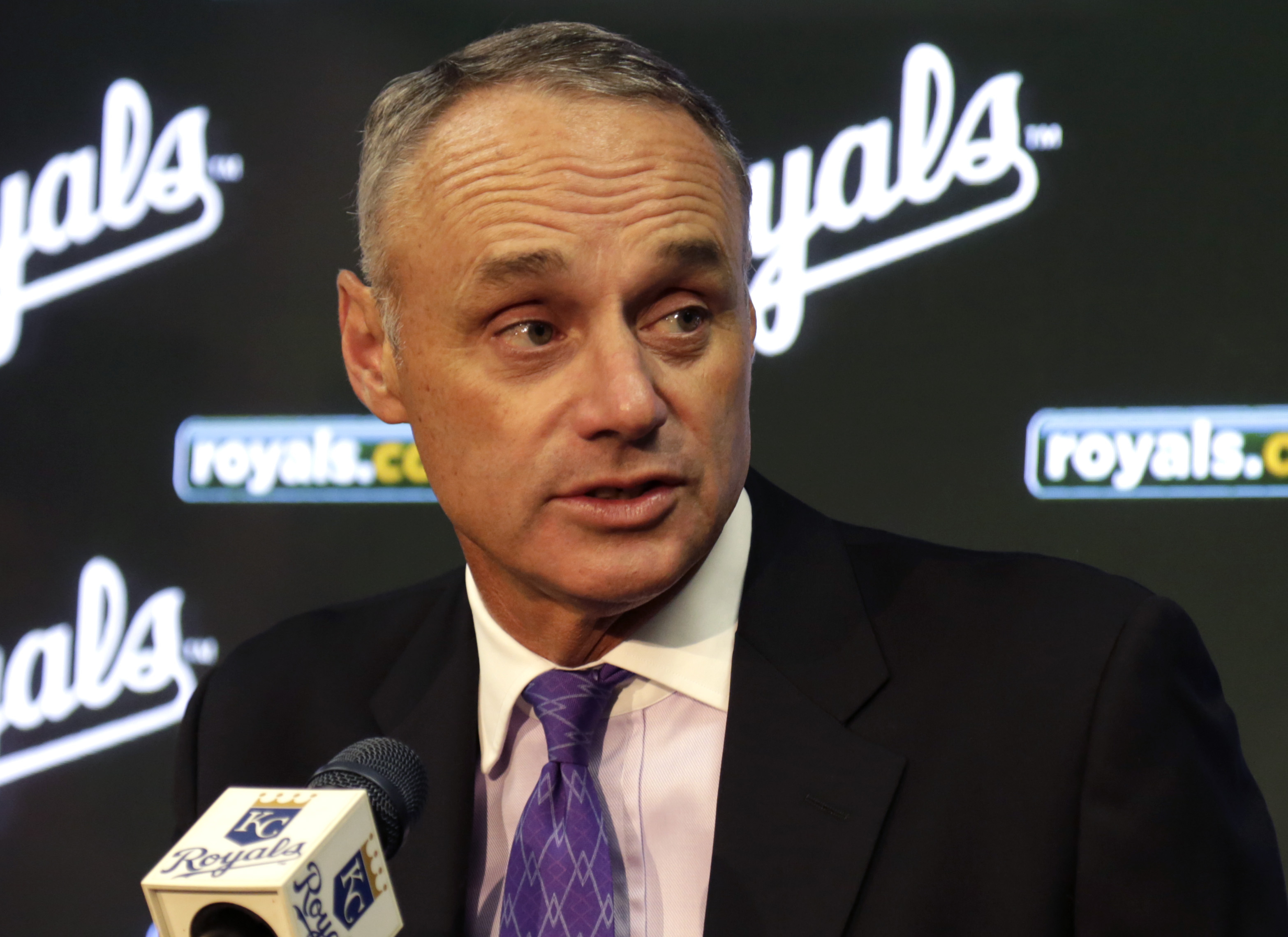 Baseball commissioner Rob Manfred answers a reporters question during a news conference before a baseball game between the Kansas City Royals and the New York Mets at Kauffman Stadium in Kansas City, Mo., Monday, April 4, 2016. (AP Photo/Colin E. Braley)