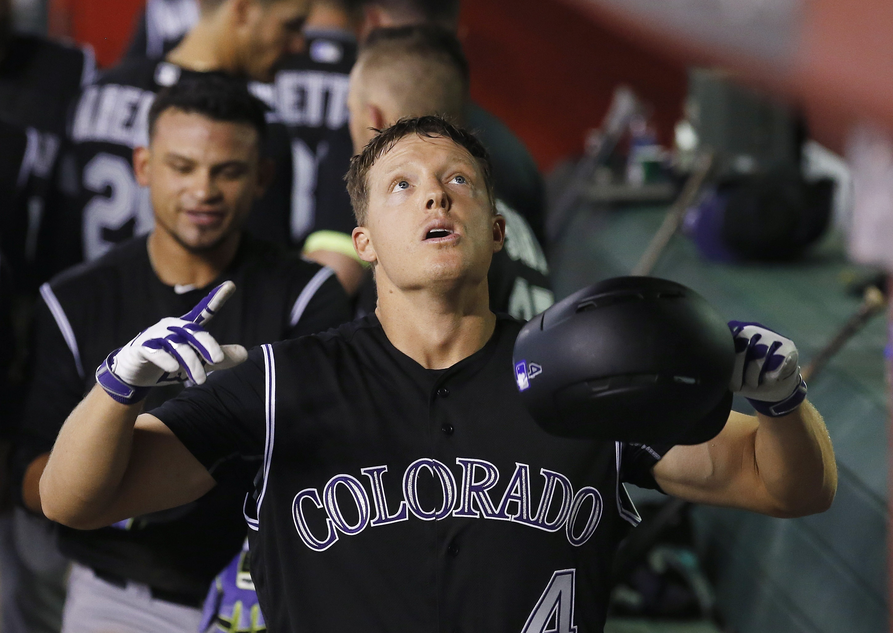 Colorado Rockies' Nick Hundley looks up as he celebrates his three-run home run against the Arizona Diamondbacks during the fourth inning of a baseball game Tuesday, April 5, 2016, in Phoenix. (AP Photo/Ross D. Franklin)