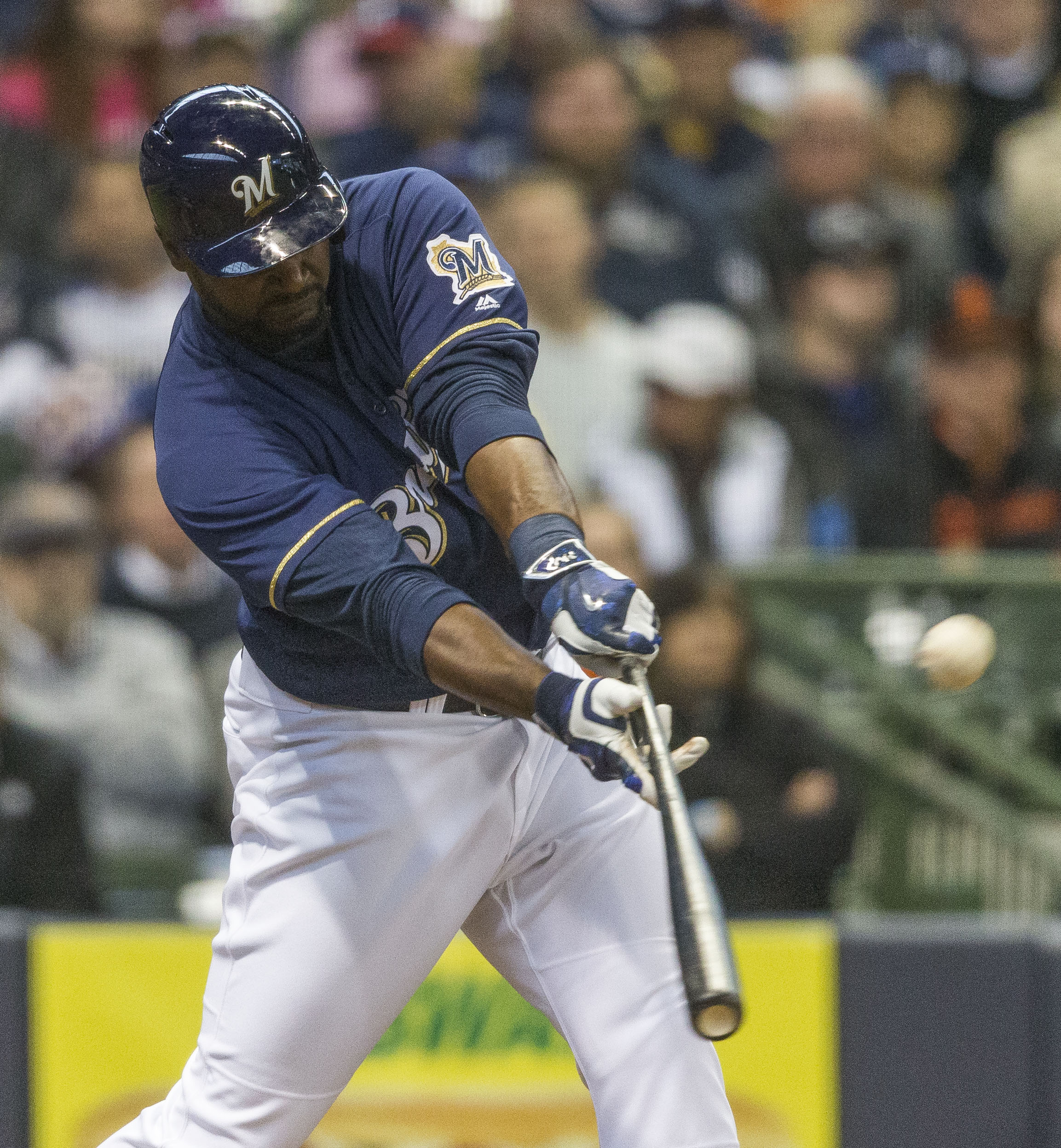 Milwaukee Brewers' Chris Carter connects for a sacrifice fly giving the Brewers the lead over the San Fransisco Giants during the seventh inning of a baseball game Wednesday, April 6, 2016, in Milwaukee. (AP Photo/Tom Lynn)