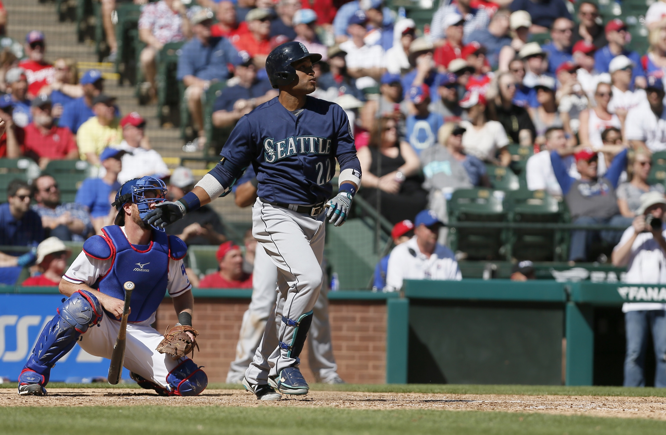 Seattle Mariners Robinson Cano (22) watches as his hit goes for a two-run home run during the ninth inning of a baseball game against the Texas Rangers Wednesday, April 6, 2016, in Arlington, Texas. (AP Photo/Brandon Wade)