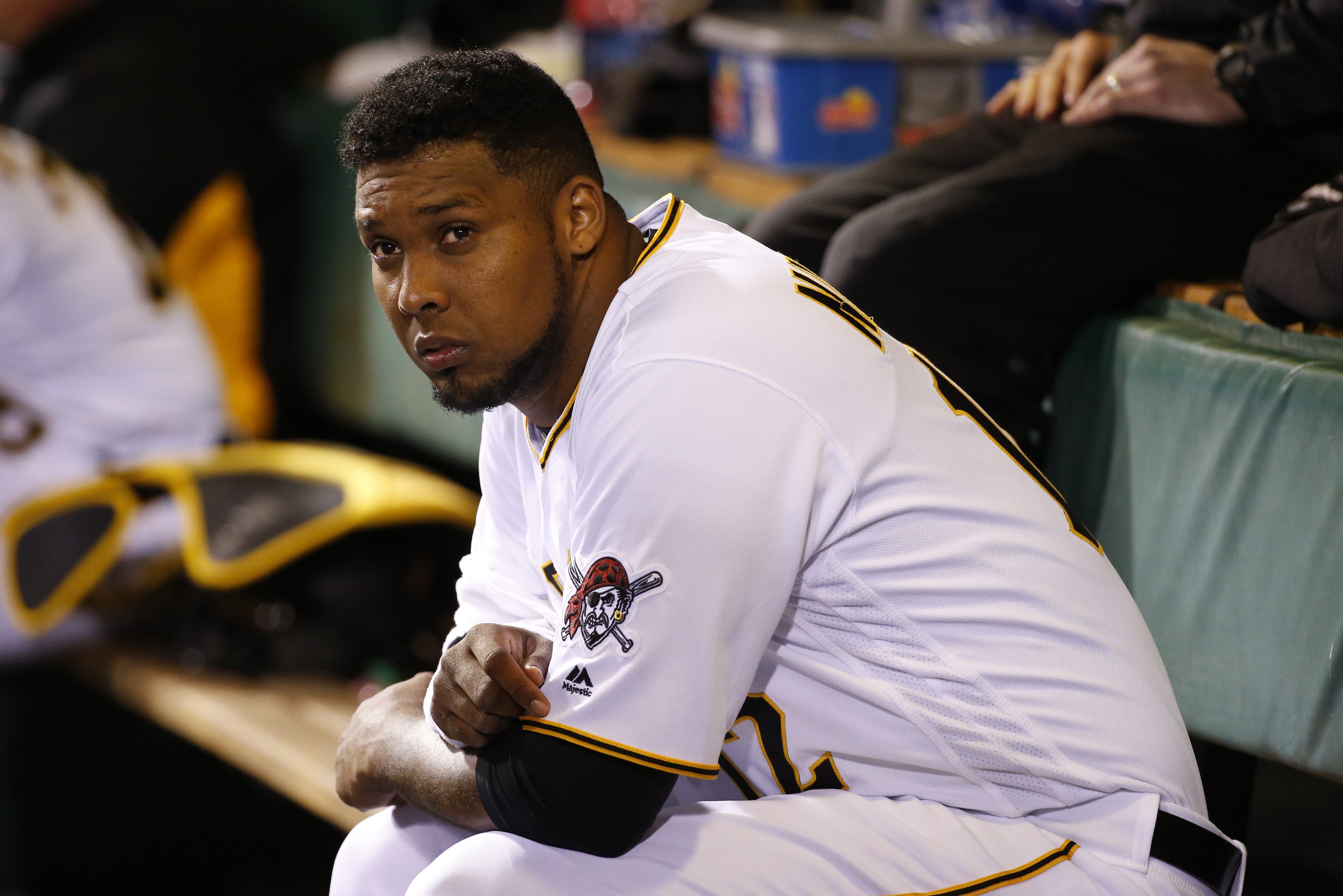Pittsburgh Pirates pitcher Juan Nicasio sits in the dugout during the fifth inning of the team's baseball game against the St. Louis Cardinals in Pittsburgh, Wednesday, April 6, 2016. (AP Photo/Gene J. Puskar)