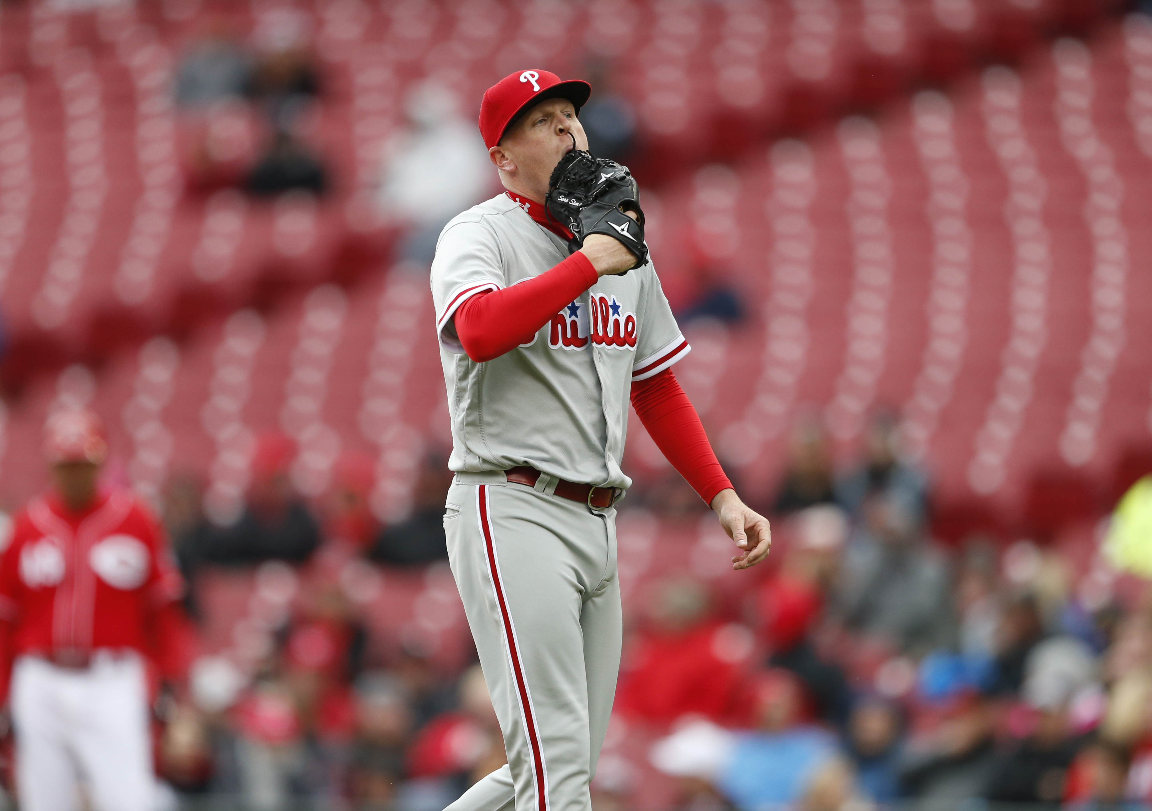 Philadelphia Phillies relief pitcher Daniel Stumpf walks to the dugout after being pulled from the game during the fourth inning of a baseball game against the Cincinnati Reds, Thursday, April 7, 2016, in Cincinnati. (AP Photo/Gary Landers)