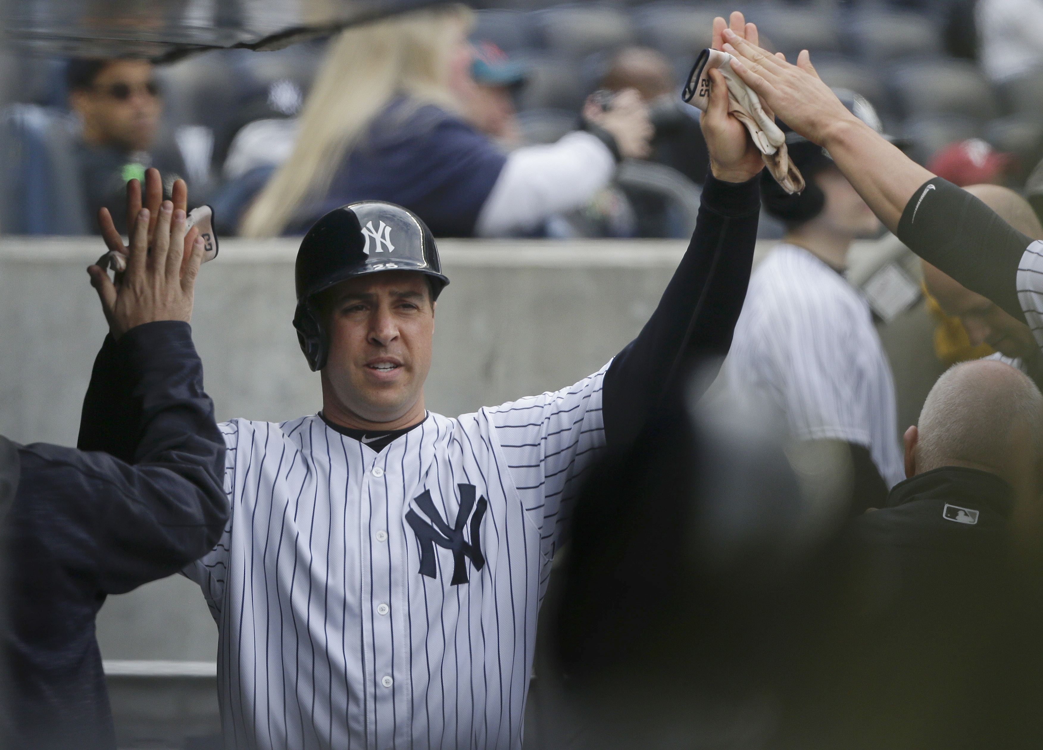 New York Yankees Mark Teixeira is greeted in the dugout after scoring against the Houston Astros during the second inning of a baseball game, Thursday, April 7, 2016, in New York. (AP Photo/Julie Jacobson)