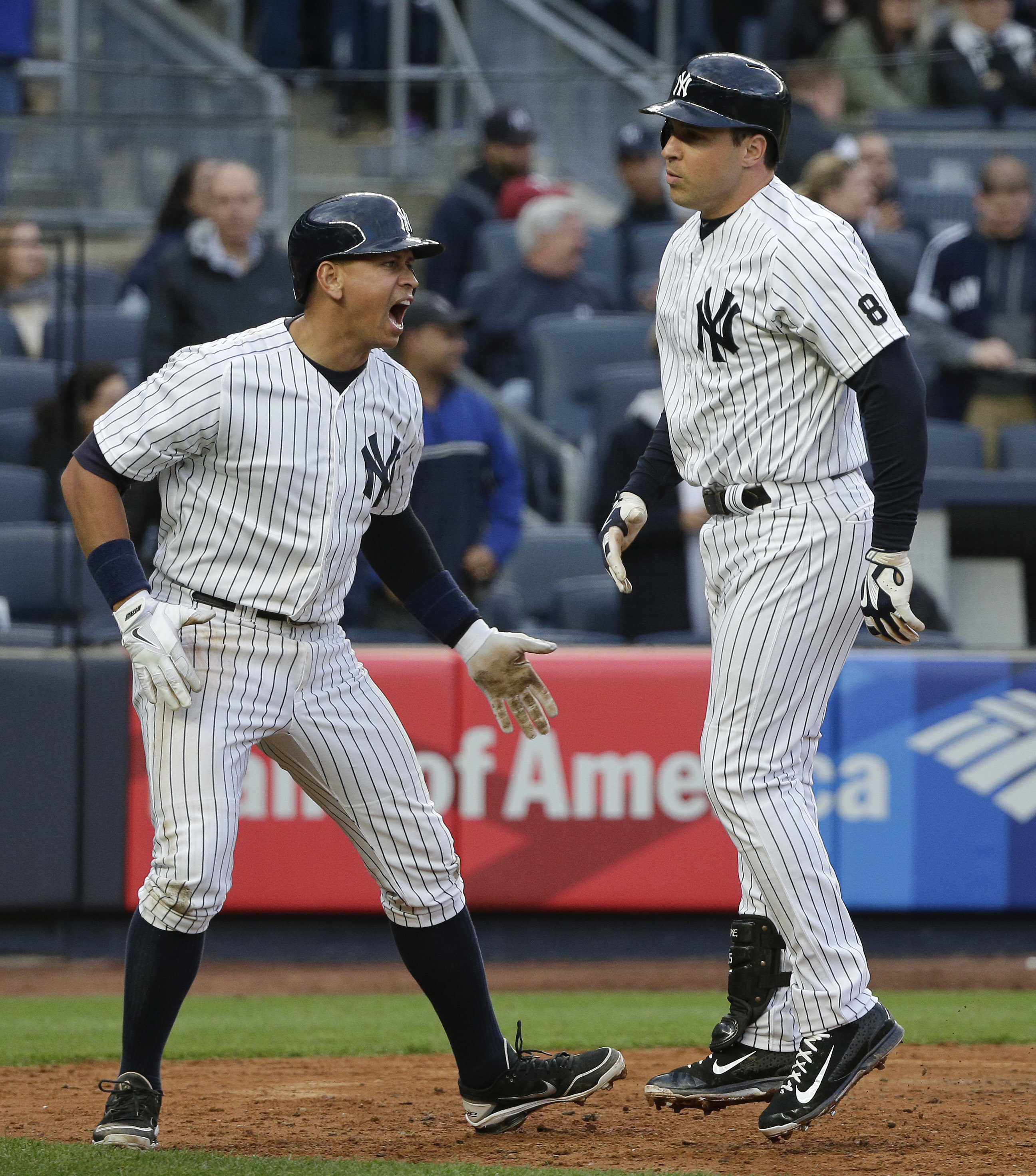 New York Yankees' Mark Teixeira, right, is greeted by Alex Rodriguez at the plate after hitting a three-run home run against the Houston Astros during the seventh inning of a baseball game Thursday, April 7, 2016, in New York. (AP Photo/Julie Jacobson)