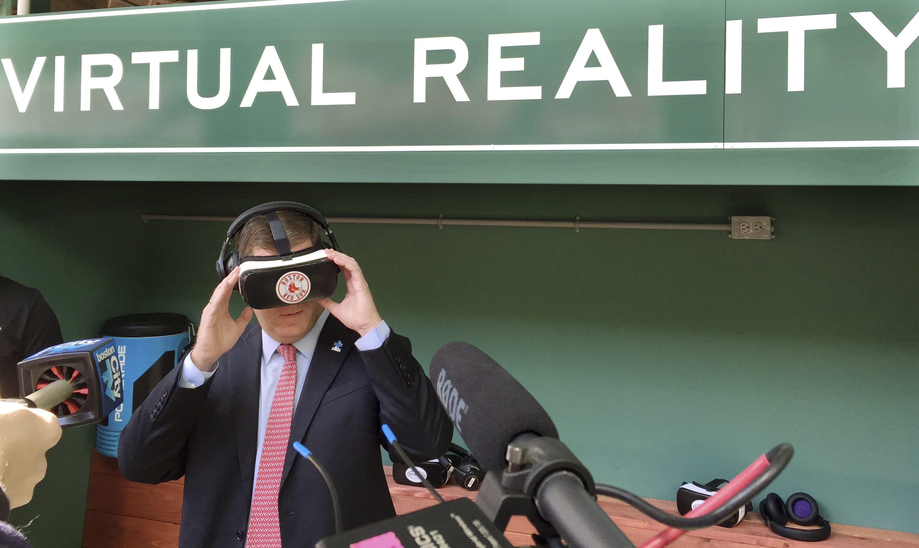 Boston Mayor Marty Walsh tries out a virtual reality device during a tour of the latest improvements at Fenway Park Friday, April 8, 2016, in Boston, in advance of Monday's Boston Red Sox home opener against the Baltimore Orioles. The free, two-minute vir