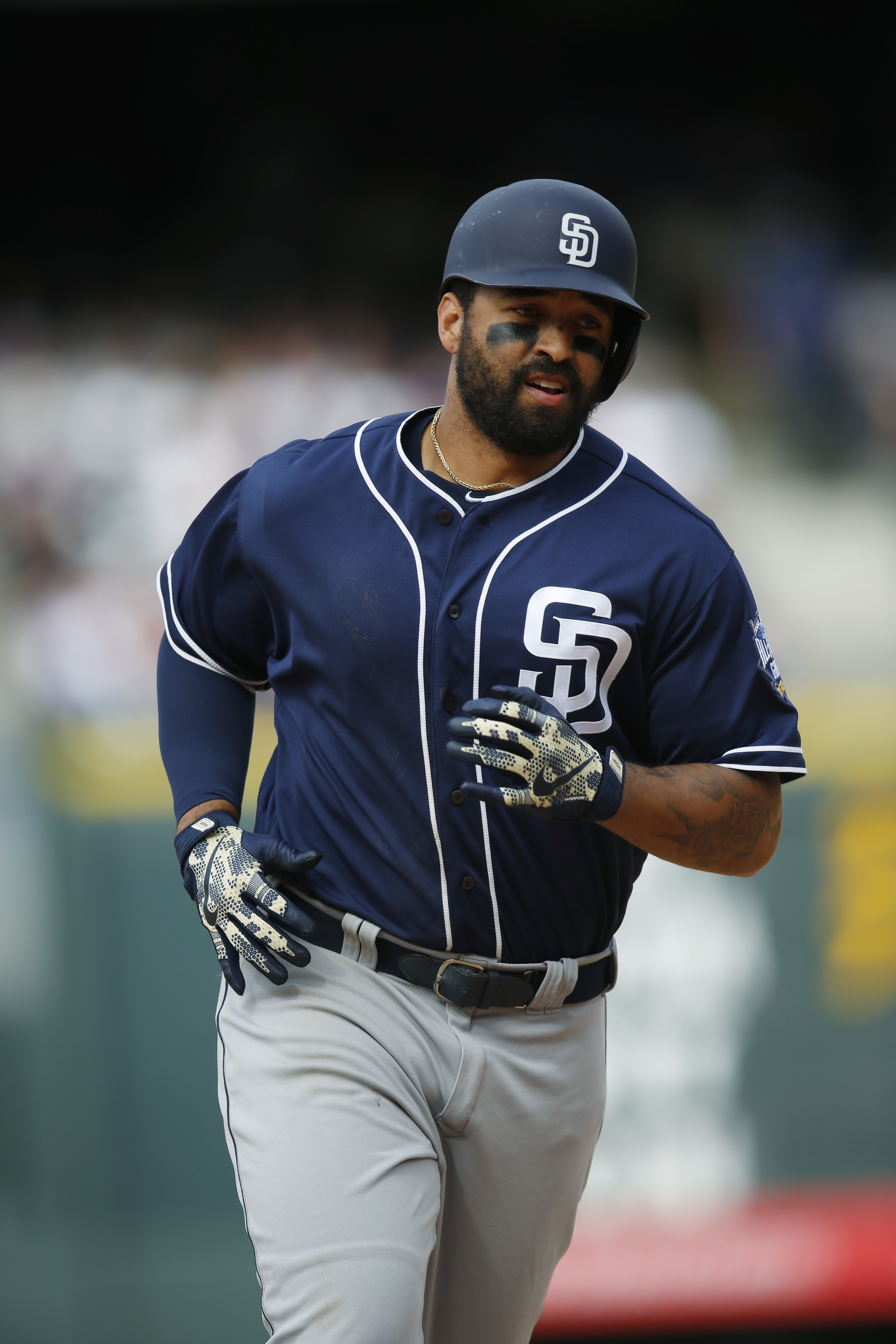 San Diego Padres' Matt Kemp circles the bases after hitting a three-run home run off Colorado Rockies relief pitcher Justin Miller in the fifth inning of a baseball game Friday, April 8, 2016, in Denver. (AP Photo/David Zalubowski)