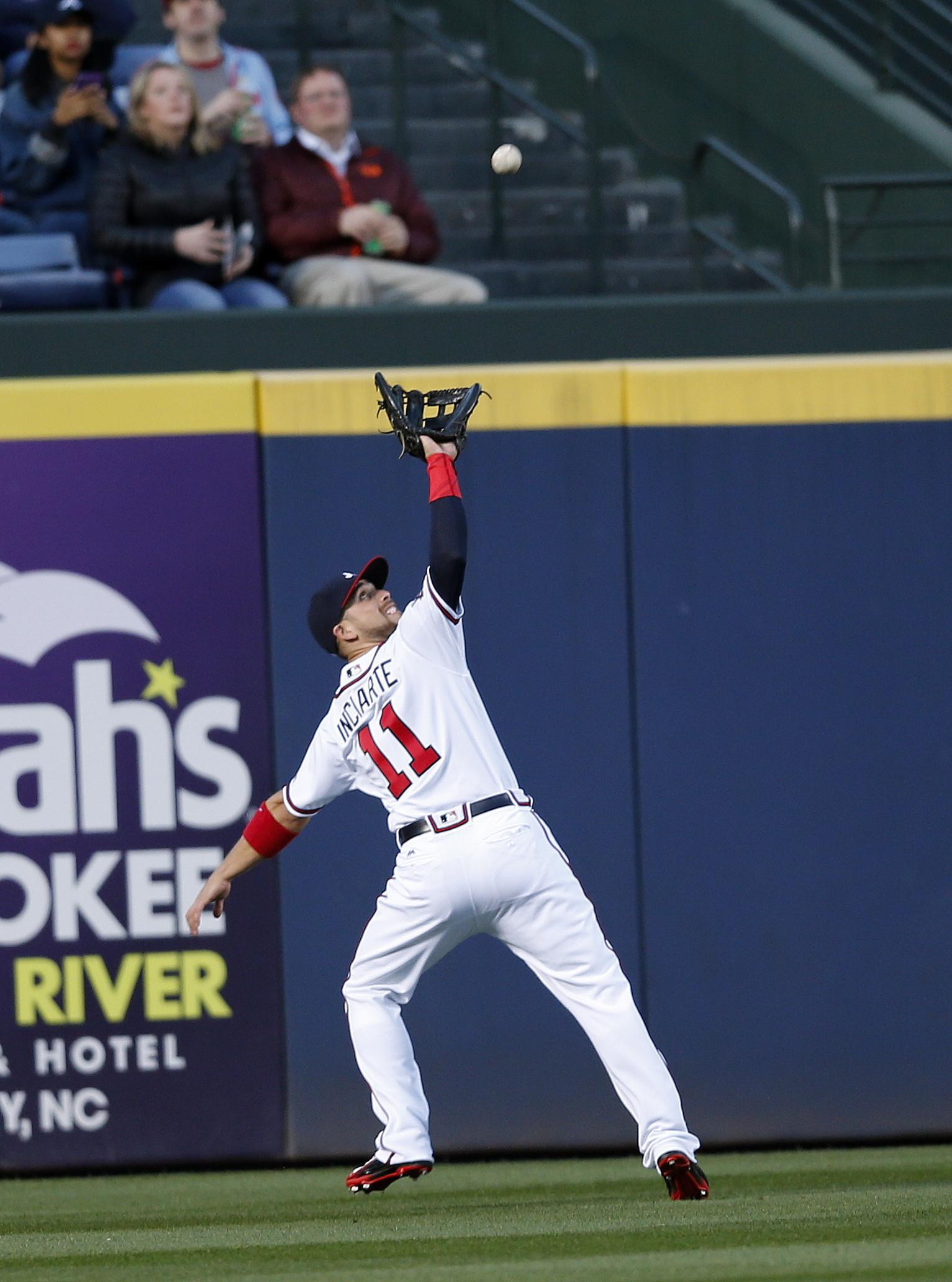 Atlanta Braves center fielder Ender Inciarte (11) gets under a fly ball off the bat of St. Louis Cardinals' Matt Carpenter in the first inning of a baseball game Friday, April 8, 2016, in Atlanta. (AP Photo/John Bazemore)