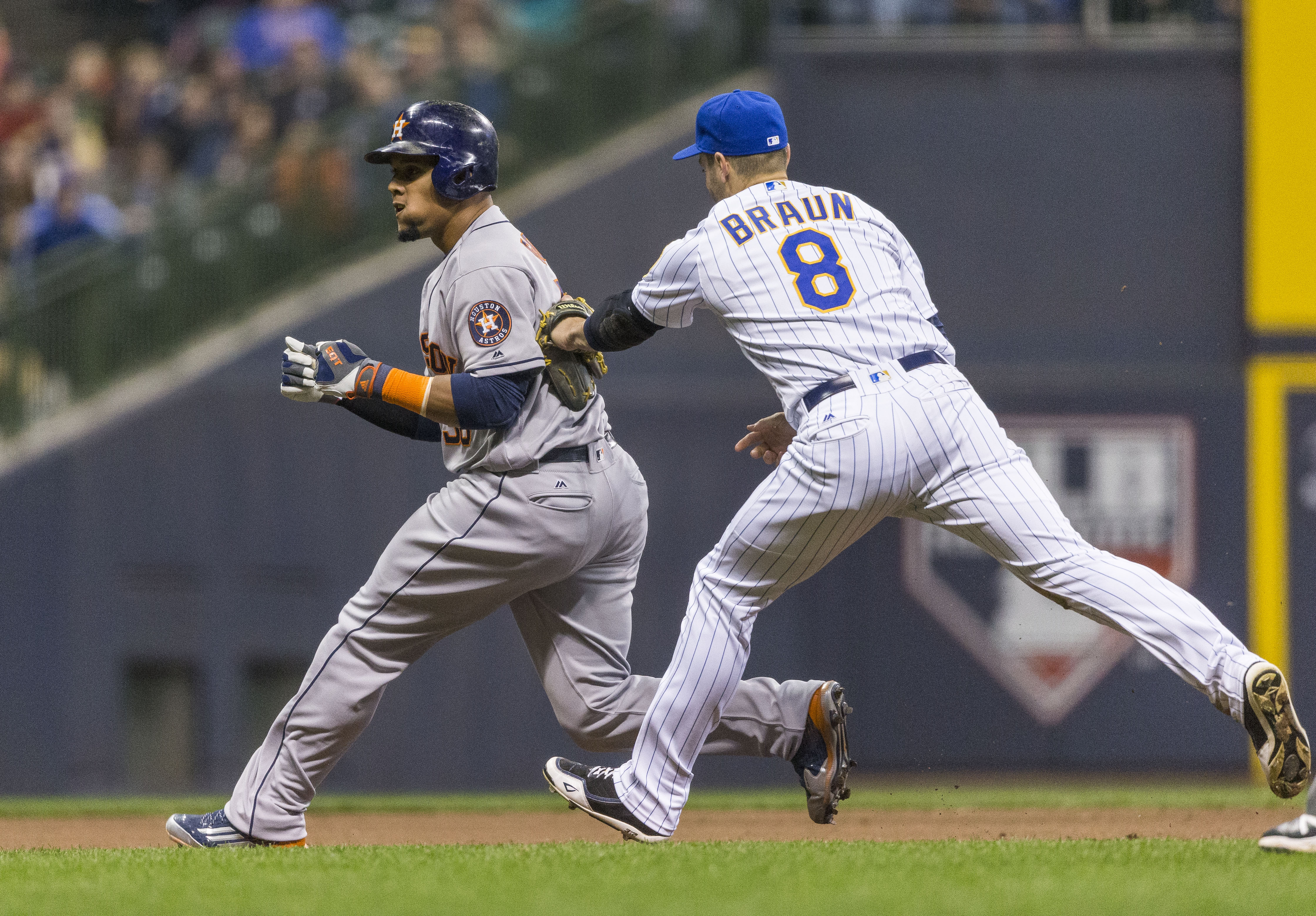 Houston Astros' Carlos Gomez, left, is caught stealing third, forcing a rundown, and tagged out by Milwaukee Brewers' Ryan Braun during the fourth inning of a baseball game Friday, April 8, 2016, in Milwaukee. (AP Photo/Tom Lynn)
