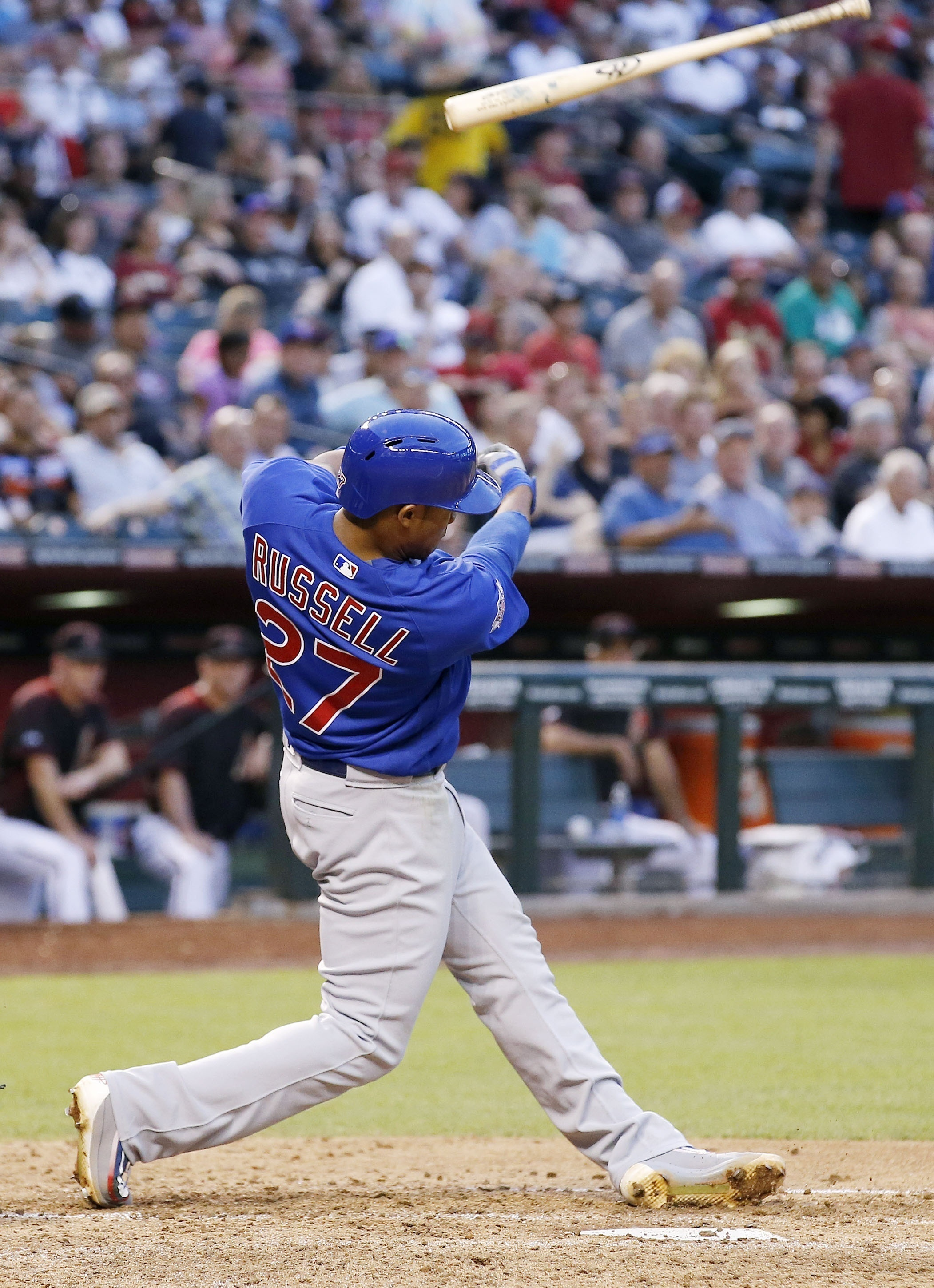 Chicago Cubs' Addison Russell loses the grip on his bat as he swings during the fifth inning of a baseball game against the Arizona Diamondbacks Saturday, April 9, 2016, in Phoenix. (AP Photo/Ross D. Franklin)