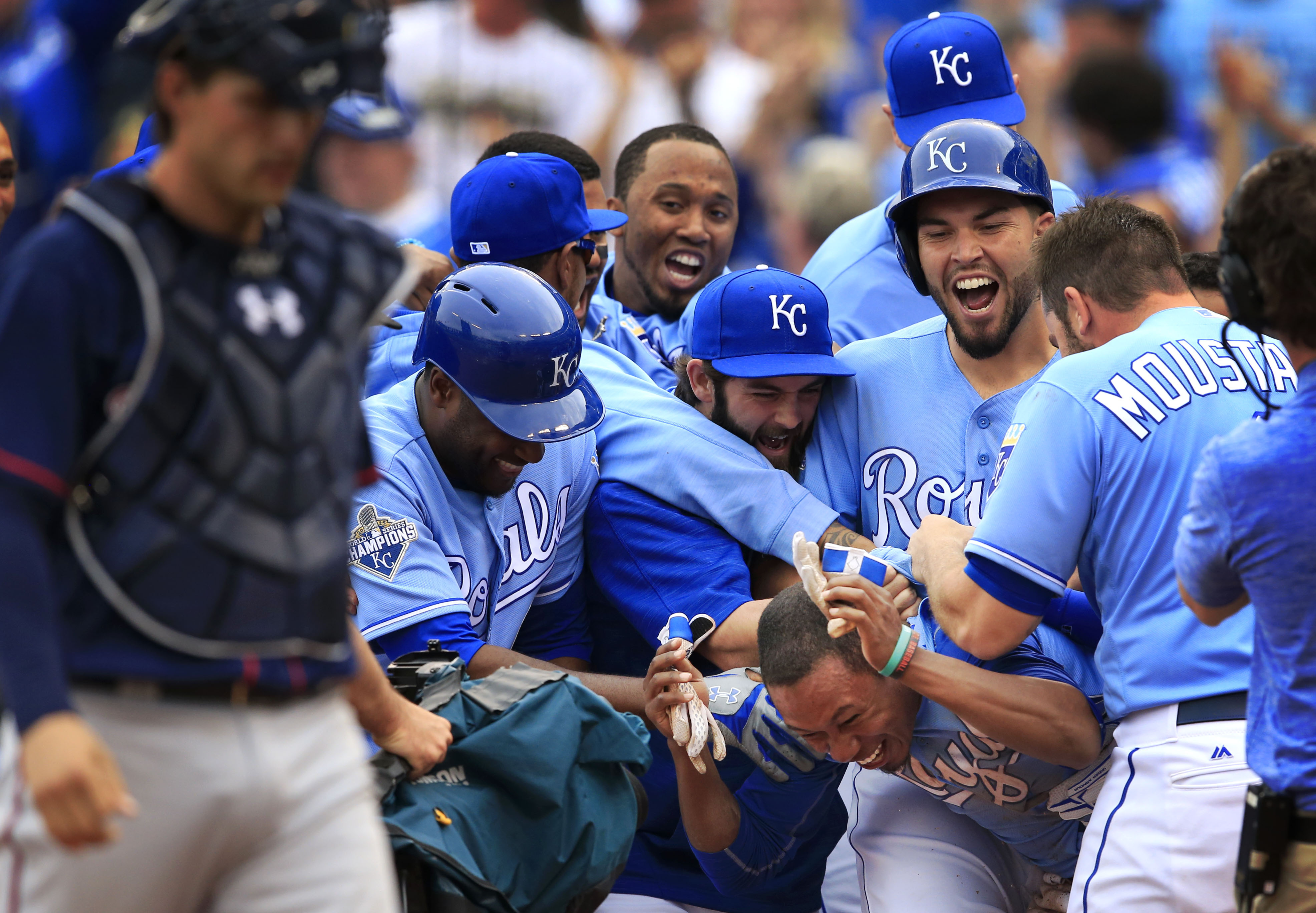 Kansas City Royals players celebrate with teammate Terrance Gore after he scored the winning run during the tenth inning of a baseball game against the Minnesota Twins at Kauffman Stadium in Kansas City, Mo., Sunday, April 10, 2016. The Royals defeated th