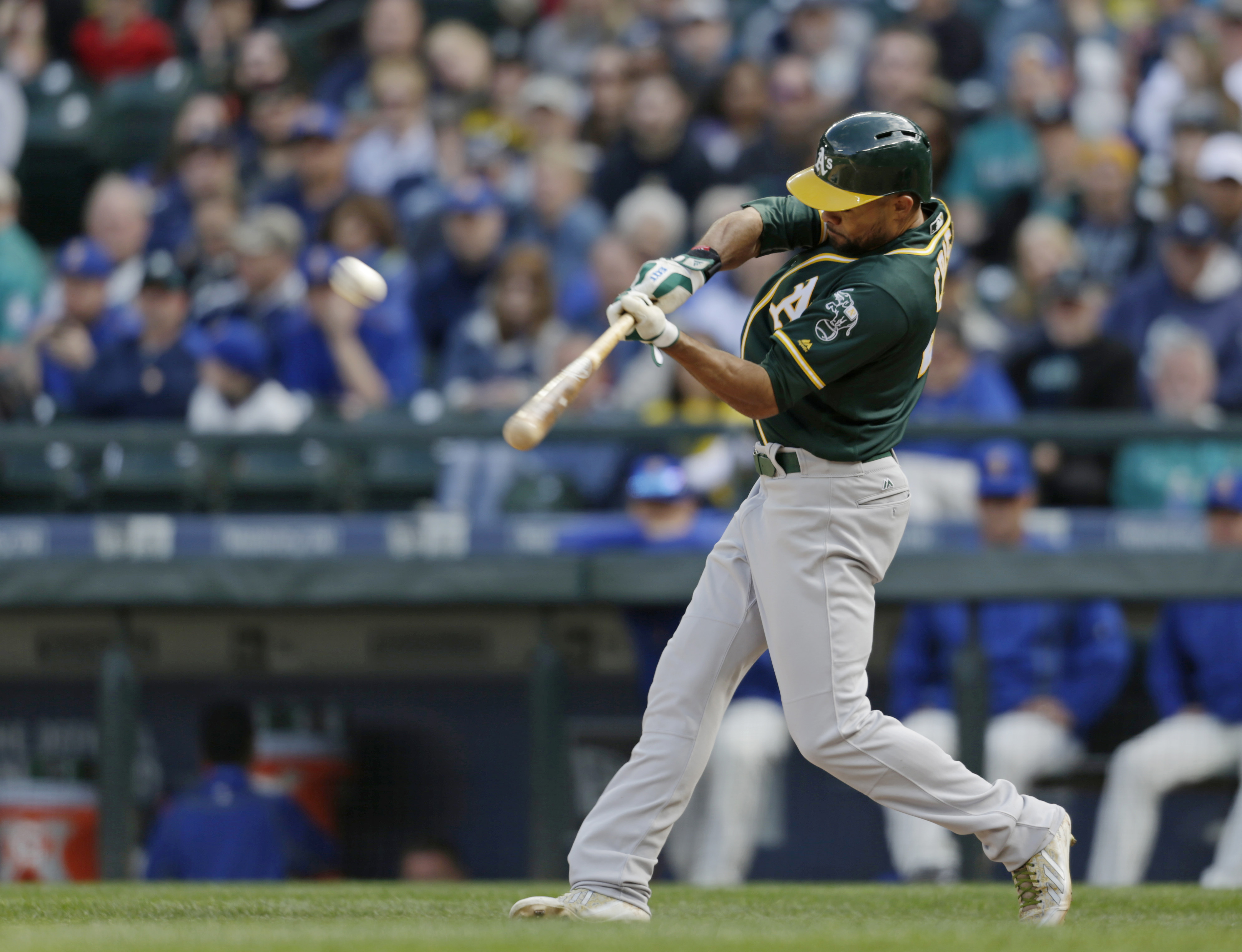 Oakland Athletics' Coco Crisp hits a solo home run on a pitch from Seattle Mariners' Nick Vincent during the 10th inning of a baseball game on Sunday, April 10, 2016, in Seattle. (AP Photo/John Froschauer)