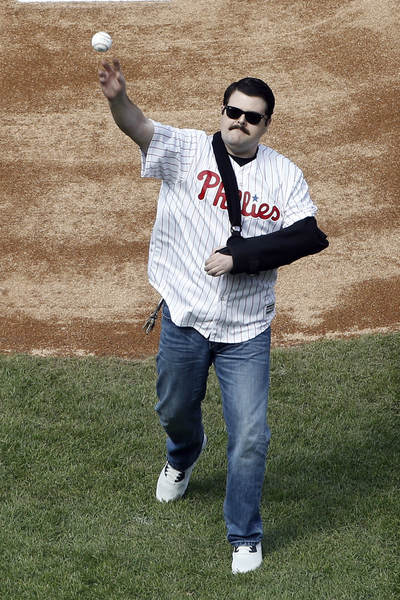 Philadelphia Police Officer Jesse Hartnett throws out a ceremonial pitch ahead of the Philadelphia Phillies home opening day baseball game against the San Diego Padres, Monday, April 11, 2016, in Philadelphia. (AP Photo/Matt Rourke)
