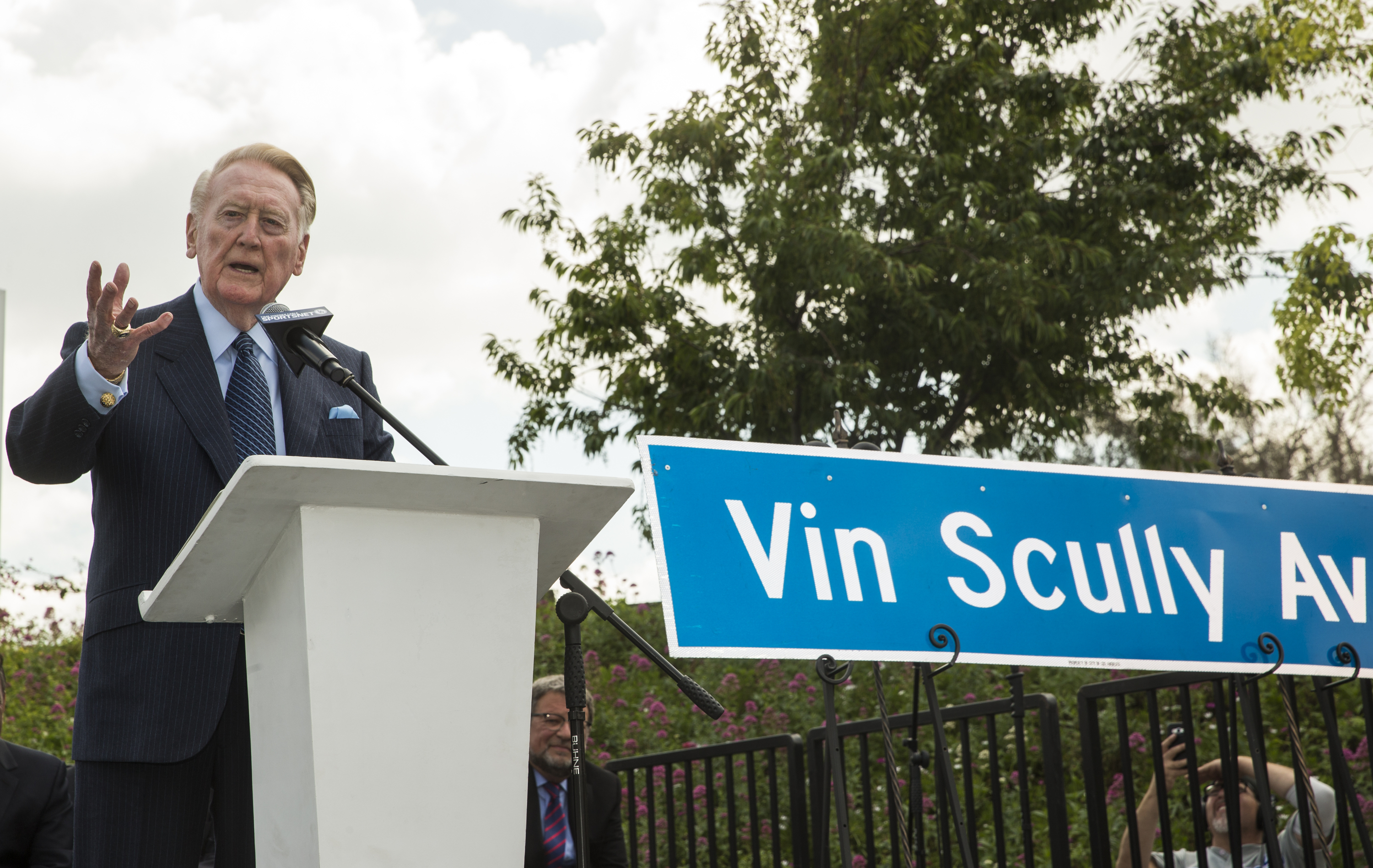 Dodger legend Vin Scully speaks at a dedication ceremony unveiling a street sign of his namesake at the entrance to Dodger Stadium in Los Angeles on Monday, April 11, 2016. Despite some opposition, the Los Angeles City Council on Friday officially renamed