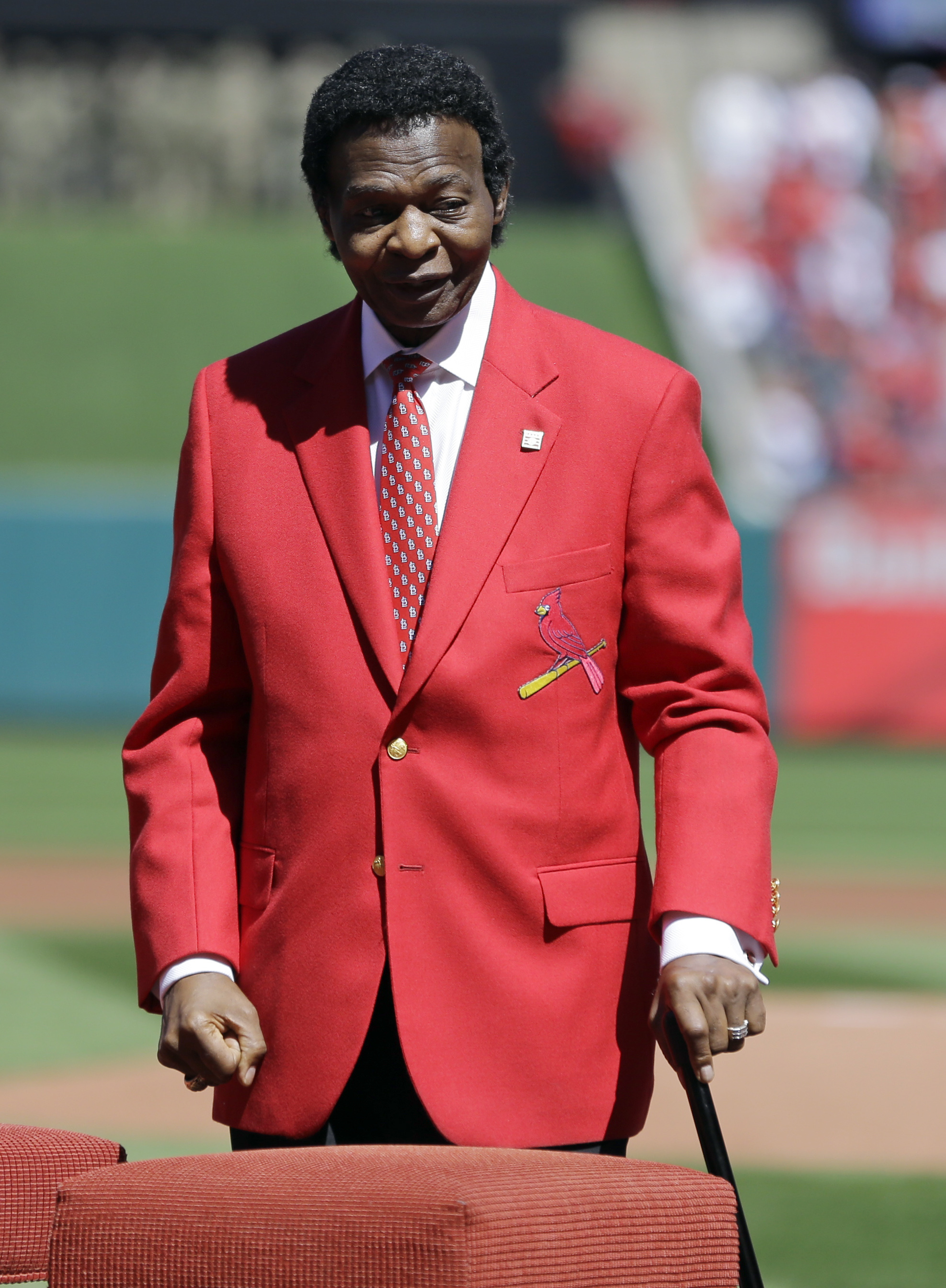 Former St. Louis Cardinals great Lou Brock is introduced before the start a baseball game between the St. Louis Cardinals and the Milwaukee Brewers Monday, April 11, 2016, in St. Louis. Brock, the former base stealing record holder and Major League Hall o